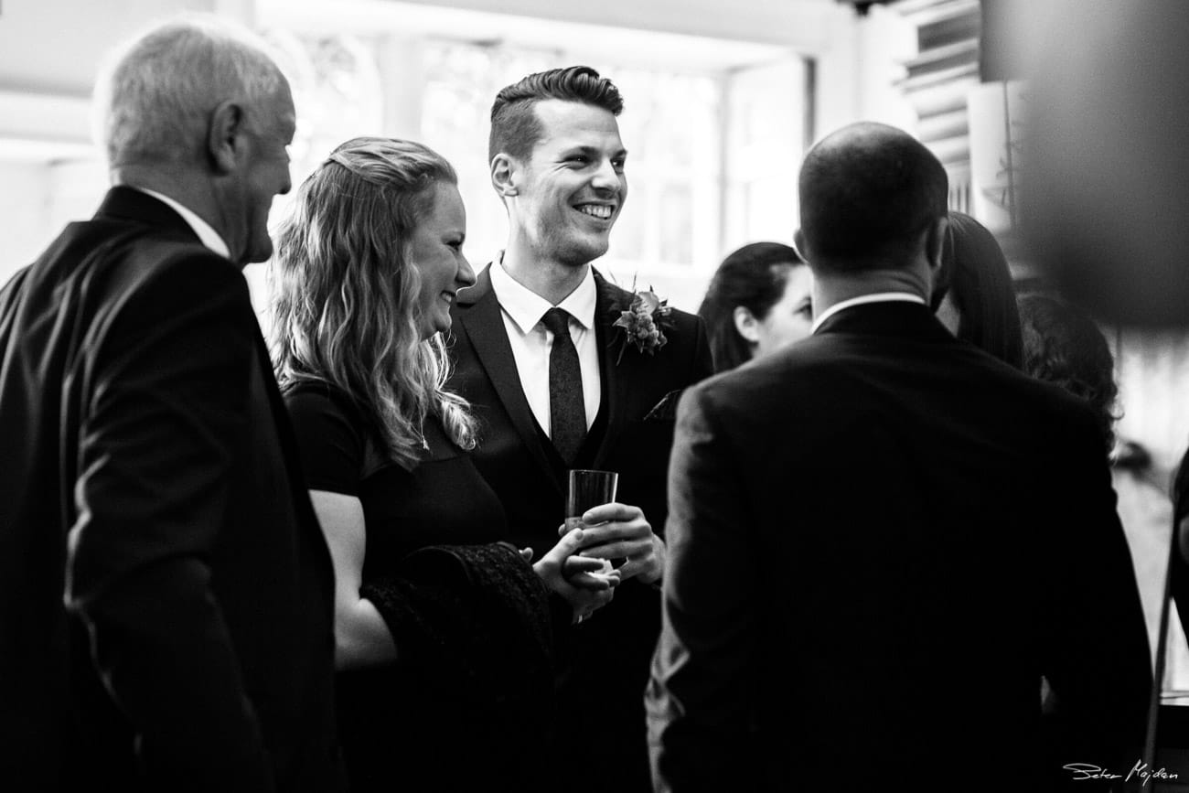 groom greeting wedding guests