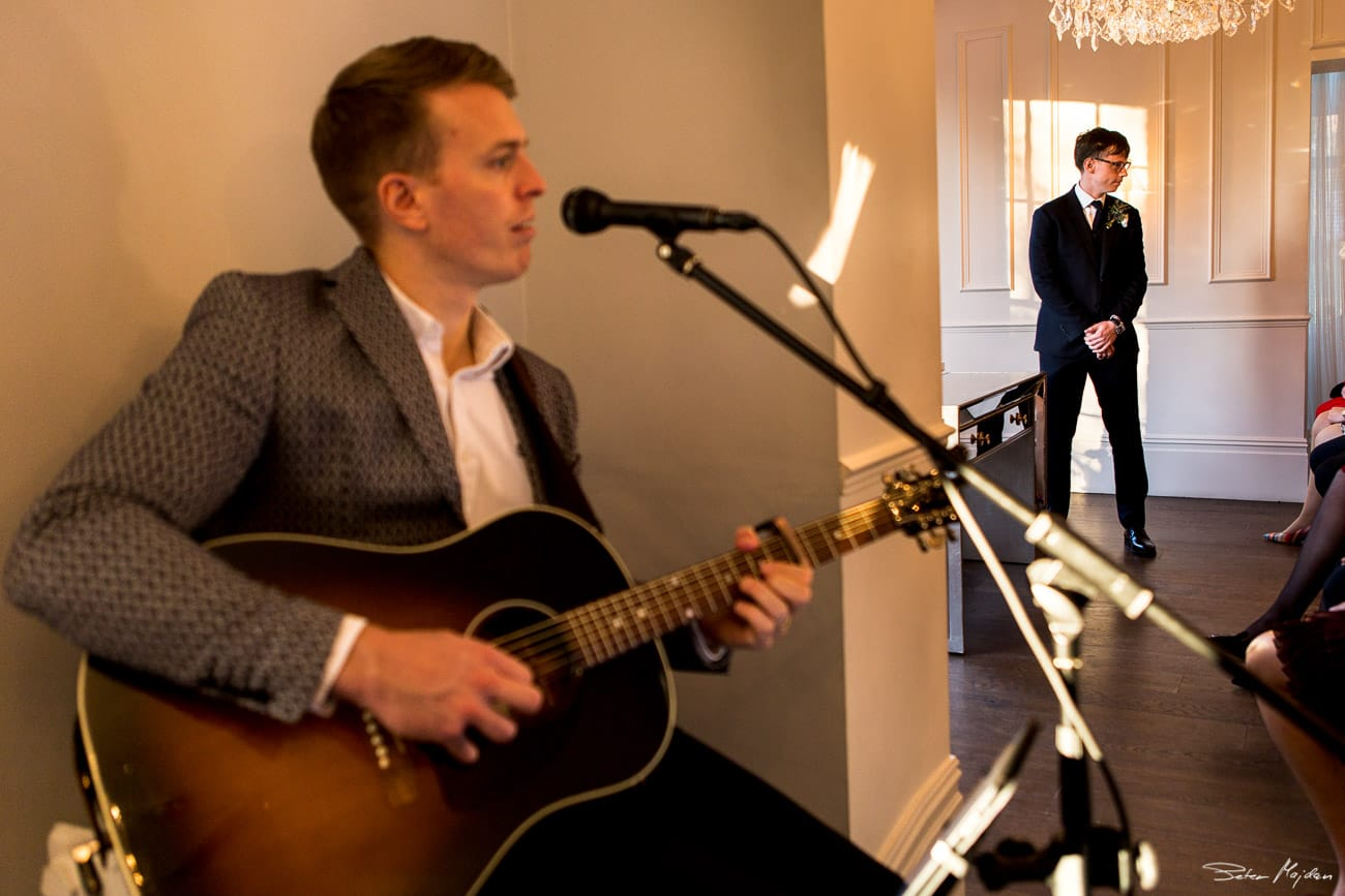 groom and singer before ceremony