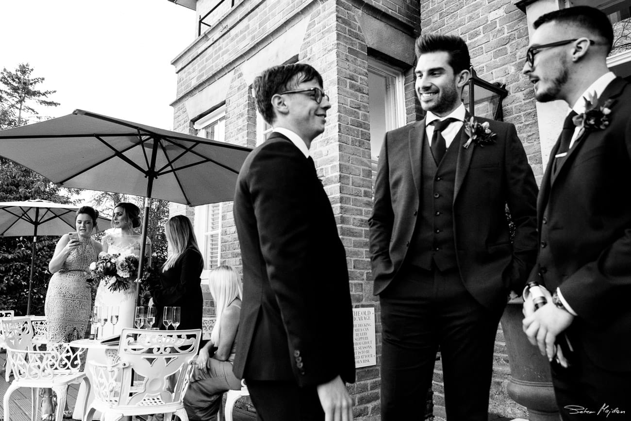groom talking with friends