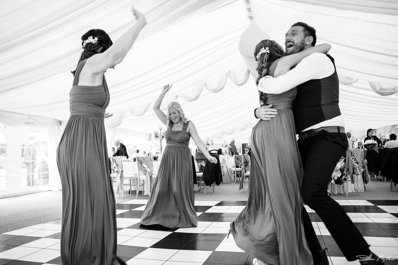 guests dancing in walled garden marquee