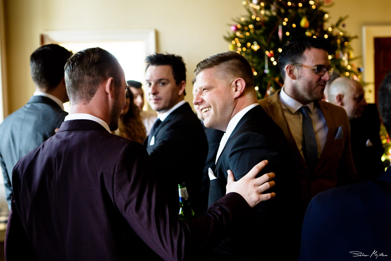 groom talking with guests