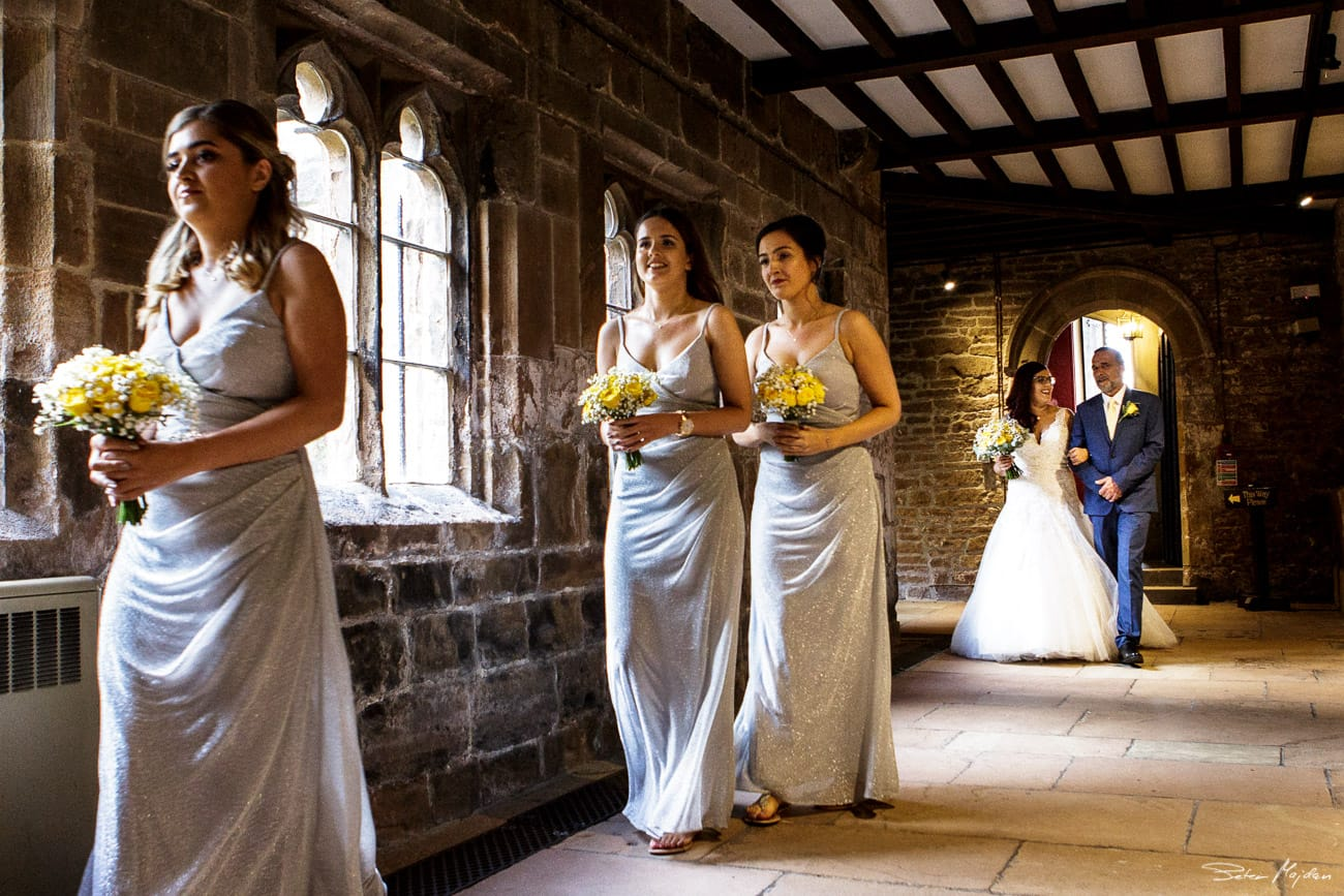 bride walking to ceremony at Newstead Abbey