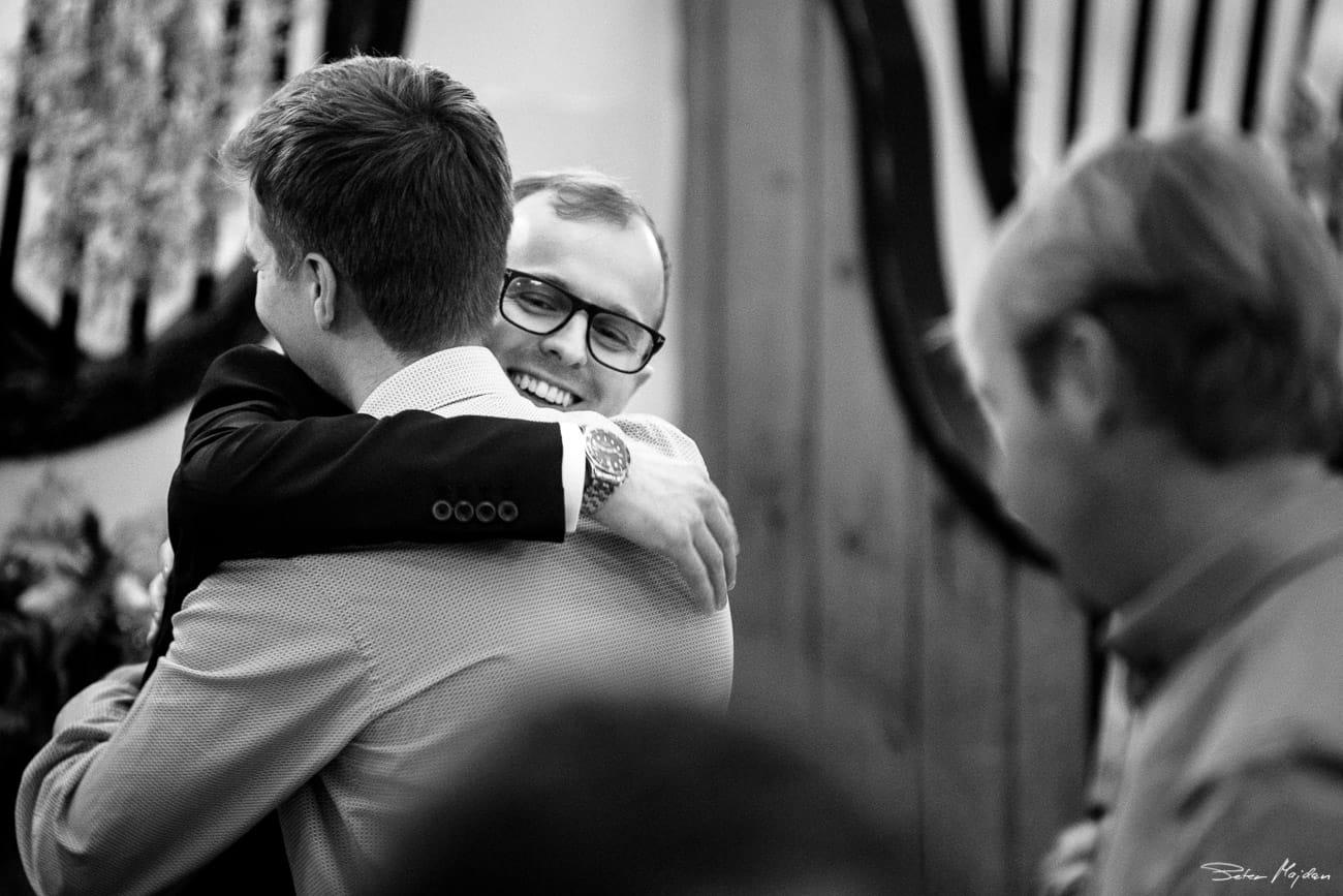 groom hugging best man