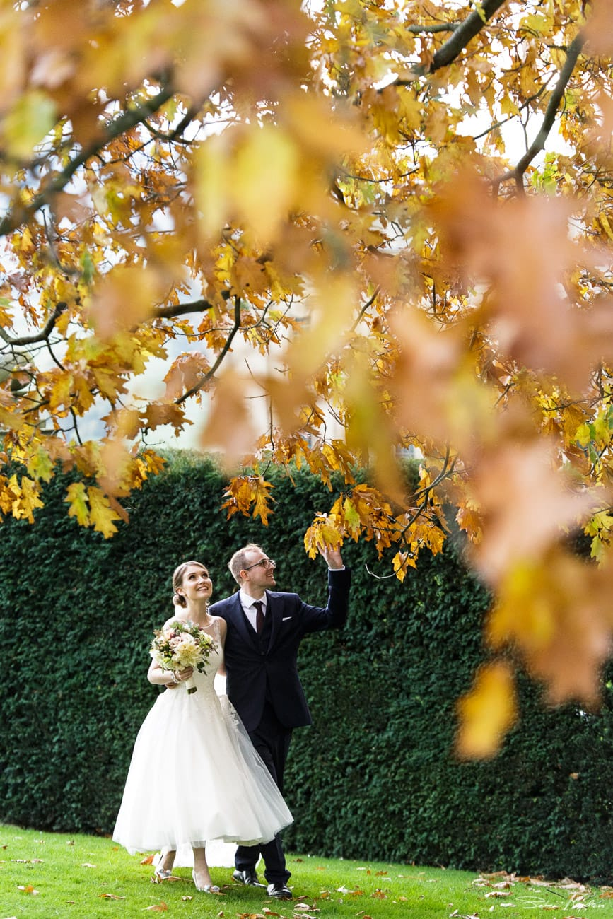 colourful autumn wedding photo of bride and groom