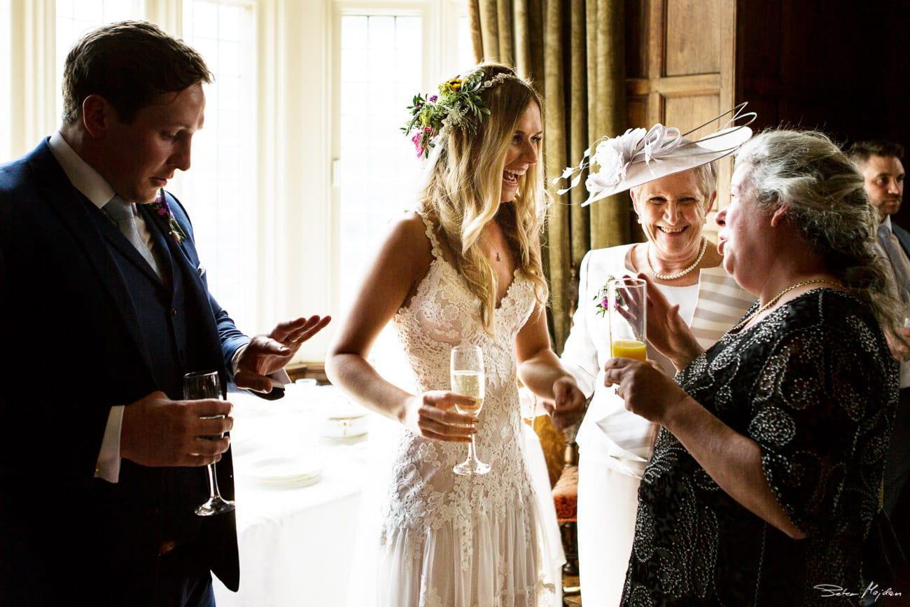 guests congratulating newlywed