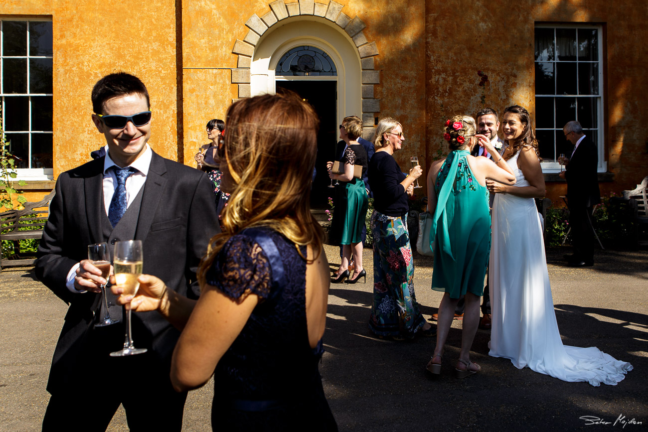 wedding guest outside Langar Hall