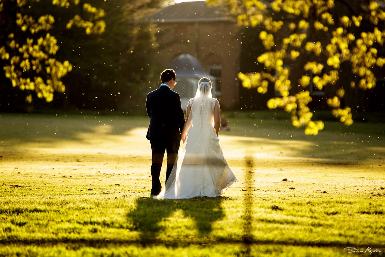 bride and groom walking during sunset