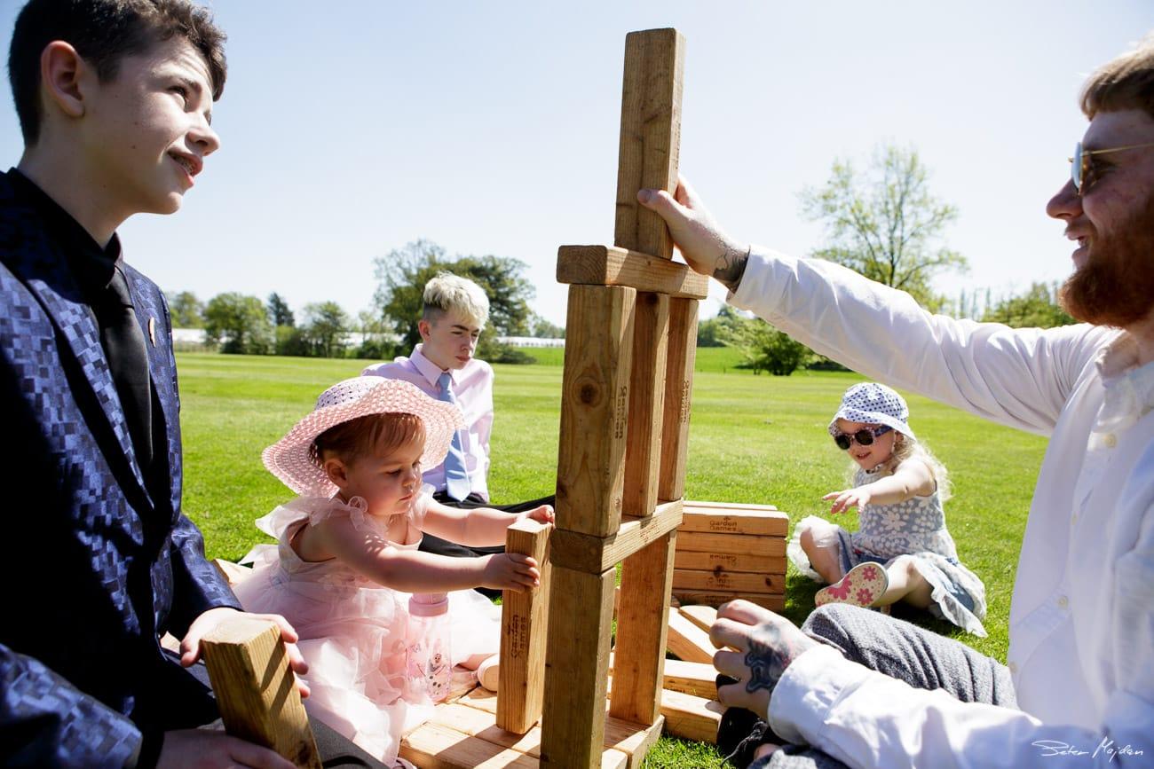 kids building jenga