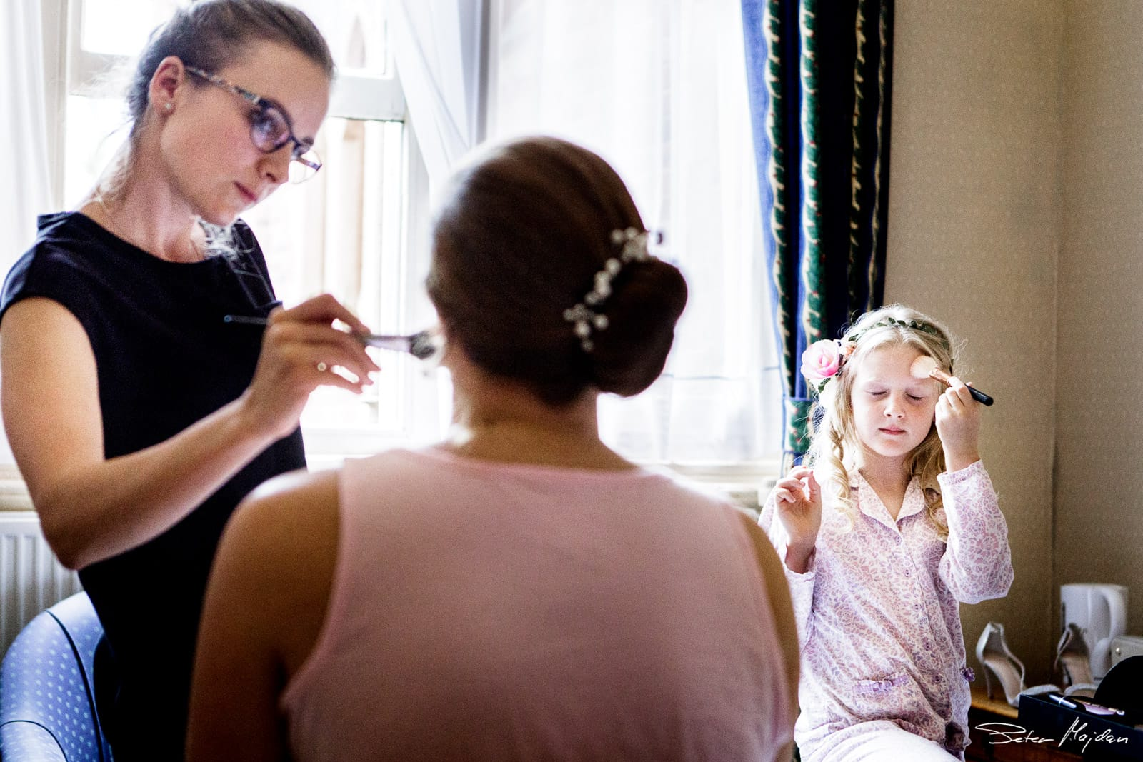 flower girl putting make up on