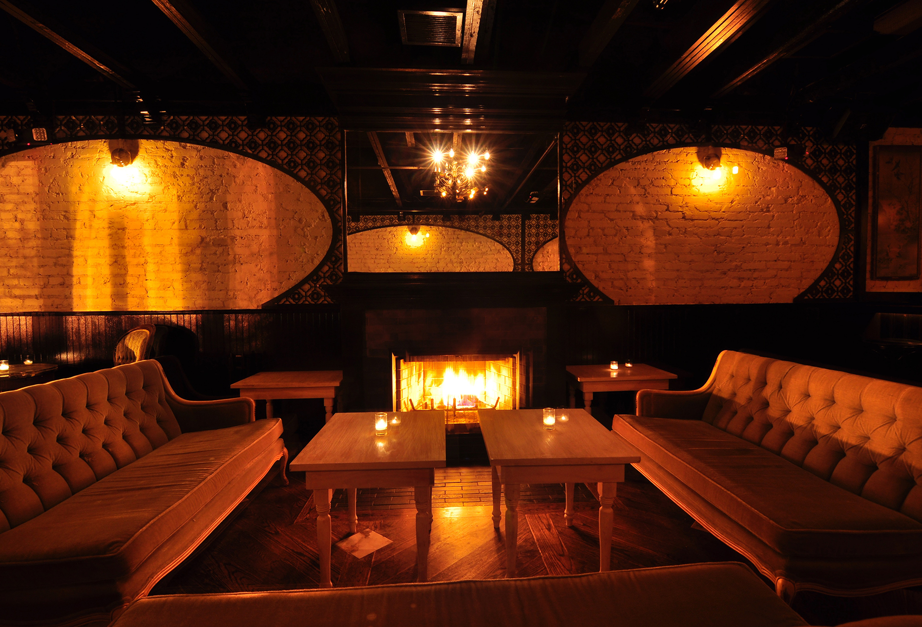 ten tigers seating area with couches dark lighting two couches facing each other.jpg
