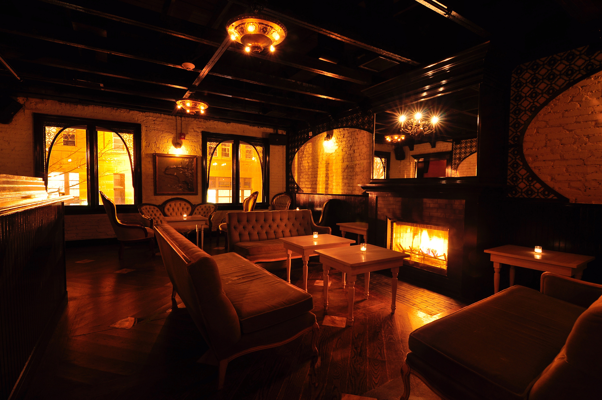 ten tigers seating area with couches dark lighting shot at an angle.jpg