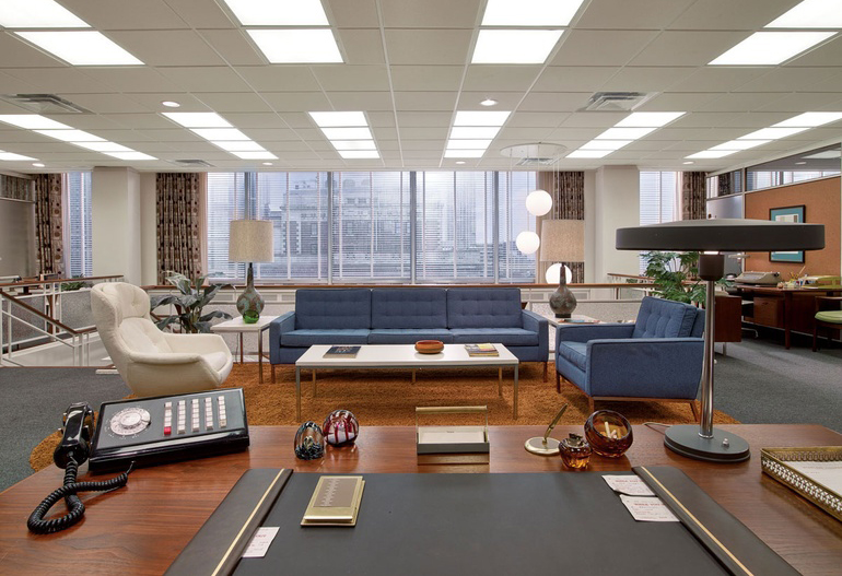 The account-executive lounge at the agency featuring a Florence Knoll style sofa and matching armchair.