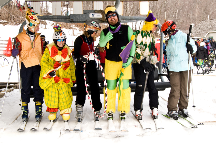 Dress on the slopes at the Wintergreen Adaptive Sports annual Mardi Gras  event is different. Held always on the first Saturday in March near the end of our snow sports season,the day begins as we launch our version of a second line parade on skis and snowboards at 11am.Traditional Mardi Gras costumes are featured alongside those designed to reflect the year's theme.Following the parade is the traditional Mardi Gras gumbo lunch served at the WAS Hut.Chicken and Sausage Gumbo, Seafood Gumbo, and at least one vegetarian option are served with French Bread and plenty of Cajun and Zydeco music.