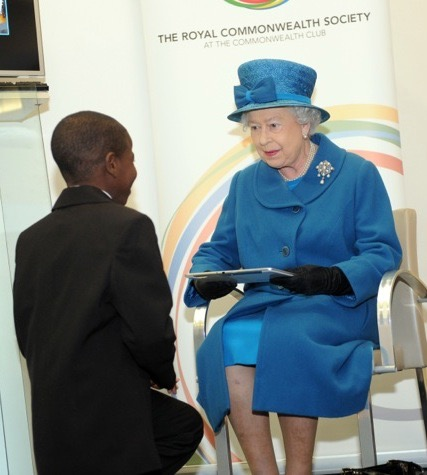 John Samson gives the Queen the tablet containing the best Commonwealth essays