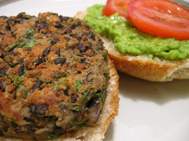 Summertime is the season of burgers.... what better time to try this homemade veggie burger recipe!? Grab everything you need to try this out on your own right here at Top Tomato.  2 + 2 tablespoons olive oil 1/2 cup sweet potato - diced 1/2 cup carrot - diced 1/2 cup onion - diced 1 clove garlic - minced 1 cup packed Olivia's Organics Baby Spinach- chopped 1/2 cup cornmeal 1/2 cup almond butter 1 teaspoon ground flax seed 1/2 teaspoon salt 1 teaspoon pepper 1 teaspoon cumin 1 teaspoon smoked paprika 1 tablespoon fresh parsley - chopped 1 cup cooked chickpeas (reserve liquid) 1/2 cup cooked black beans 1 cup cooked quinoa Whole wheat rolls Olivia's greens for serving  In a large sauté pan, heat 2 tablespoons of olive oil and sauté the first 4 vegetables for approximately 5 minutes. Add spinach and cook for another minute or 2 until soft. Set aside to cool. In a food processor, add the cooled vegetables and the remaining ingredients, until just combined. If necessary, add a little reserved liquid 1 teaspoon at a time. Shape the mixture into 8 burgers and place on a sheet pan and refrigerate for 30 minutes. Heat a large sauté pan with 2 tablespoons of olive oil and cook the burgers for 4 to 5 minutes on each side. Serve on whole wheat rolls and top with hummus or a dressing of light sour cream (or Greek yogurt) mixed with a little paprika. Add your favorite Olivia's greens and toppings.