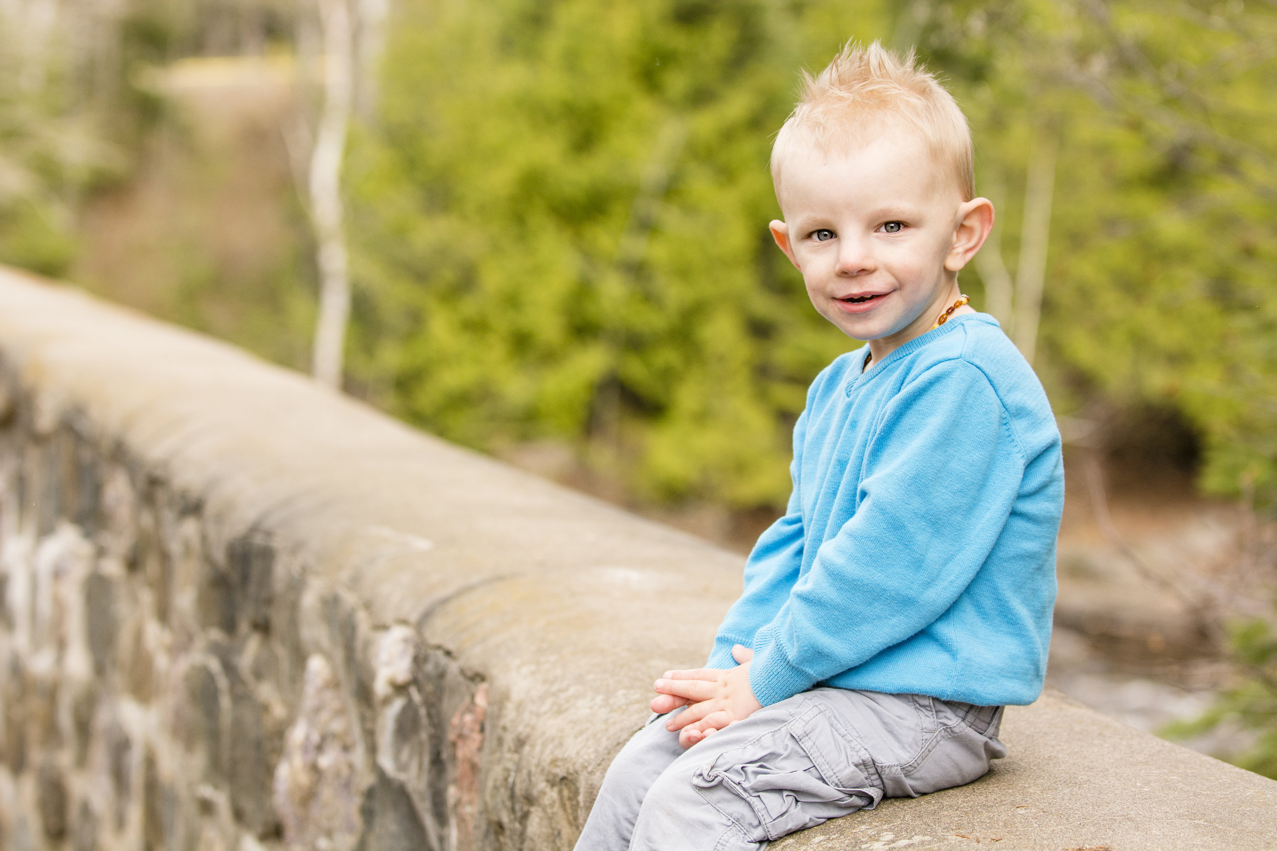 Photo of a boy on a wall taken at Centennial Park in Thunder Bay.