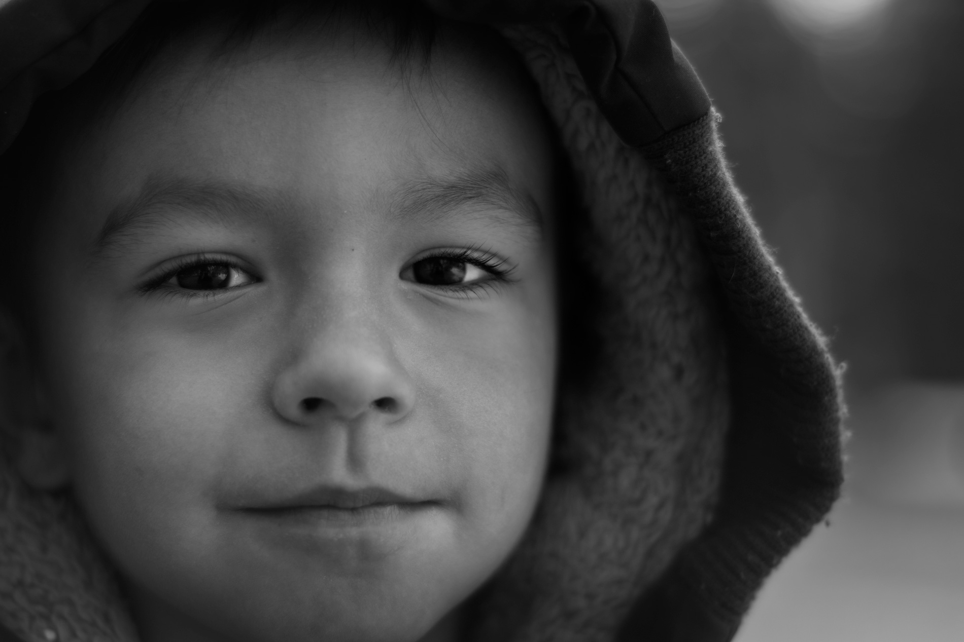 A black and white Photo of a young boy taken at Centennial Park in Thunder Bay