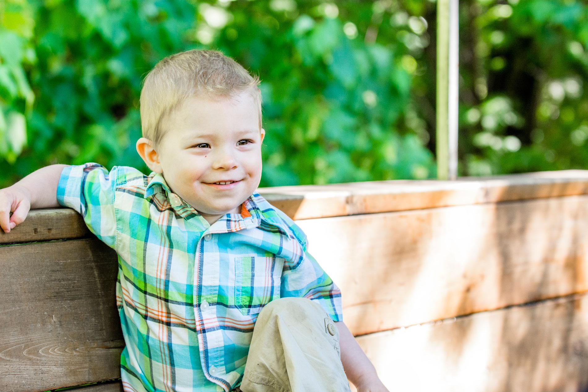 Happy boy chilling on train at Centennial Park Thunder Bay