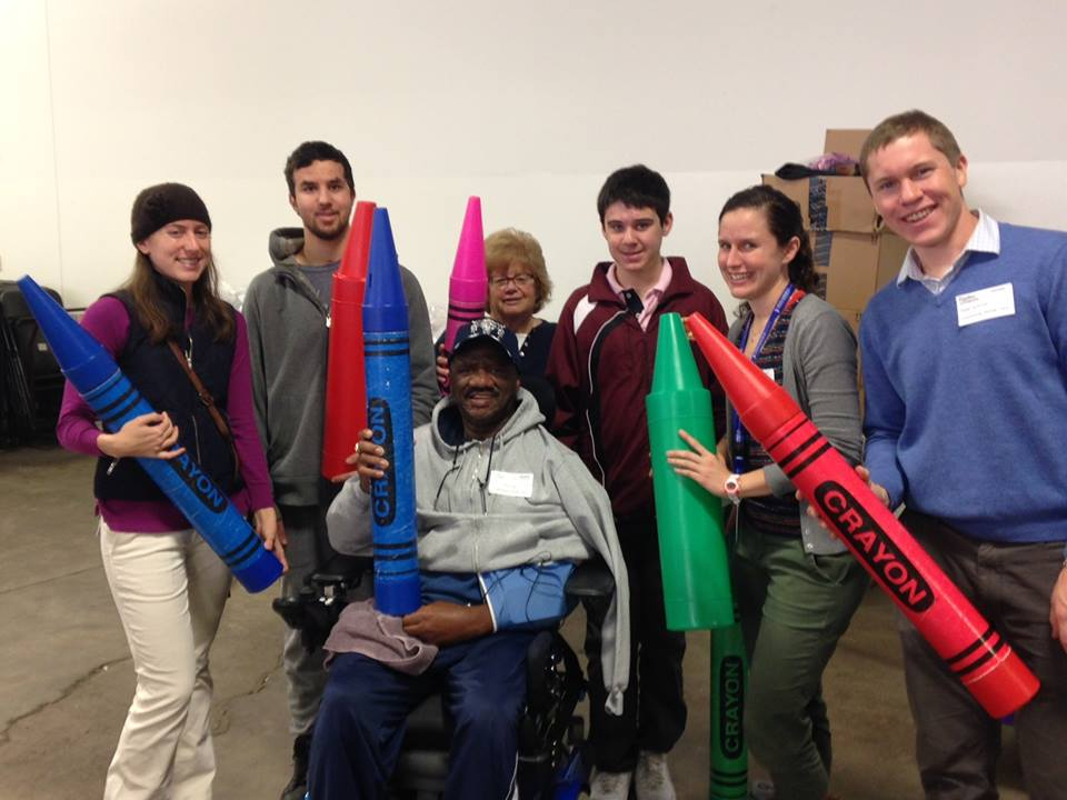 Community Rehab Care clients recovering from acquired brain injury volunteer at Cradles to Crayons to work on their skills in the community accompanied by their therapists