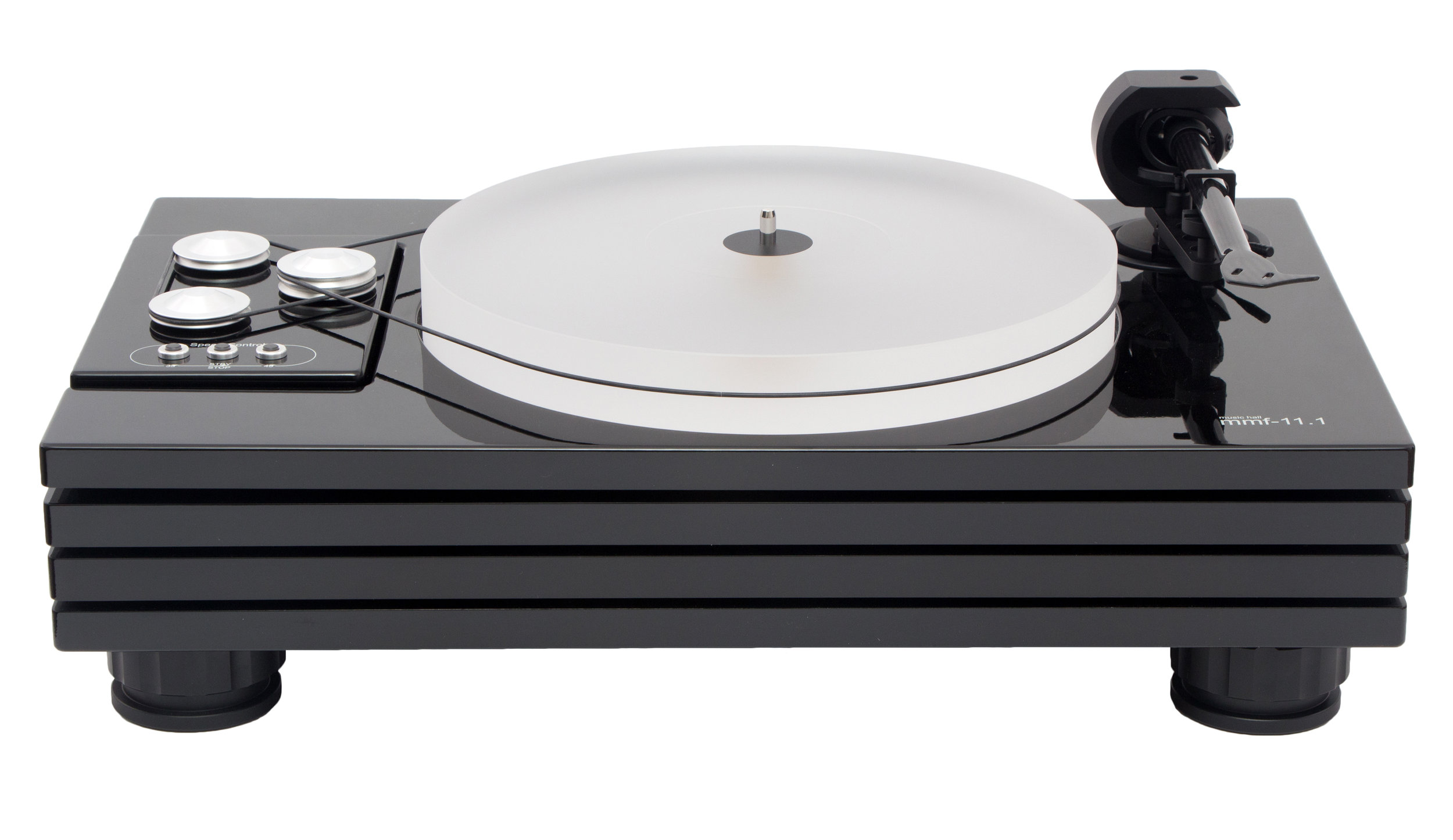 our latest flagship turntable   THE MUSIC HALL MMF-11.1 TURNTABLE, OUR LATEST FLAGSHIP, IS A 2-SPEED BELT-DRIVEN AUDIOPHILE  TURNTABLE, FEATURING THE UNIQUE QUADRUPLE-PLINTH CONSTRUCTION ORIGINATED BY MUSIC HALL.  The distinctive design isolates the critical sound reproducing components, each on their own plinth. The tonearm is mounted to the upper plinth and the inverted ceramic main bearing is mounted to the second plinth allowing the partially sunken 1 1/2″ acrylic platter to spin freely.  Moving the main bearing to the second plinth improved cartridge tracking and significantly lowered background noise. The adjustable magnetic-levitation isolation feet, microprocessor speed control, motors, flywheel, and wiring are all mounted to the bottom plinth. The motors, flywheel, and speed control are further isolated on their own vibration damped dual-plinth platform, which is separately isolated from the upper three main plinths.  Sorbothane hemispheres separate each of the three main plinths and provide additional vibration damping. The bottom plinth functions as a mass-loaded resonant sink for the entire turntable. Two motors and a flywheel are used to increase torque and speed stability. The mmf-11.1 comes in a high-gloss piano black lacquer finish and ships without cartridge. A large encapsulating acrylic dustcover is included.