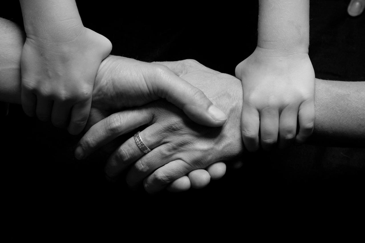 parents holding hands.jpeg
