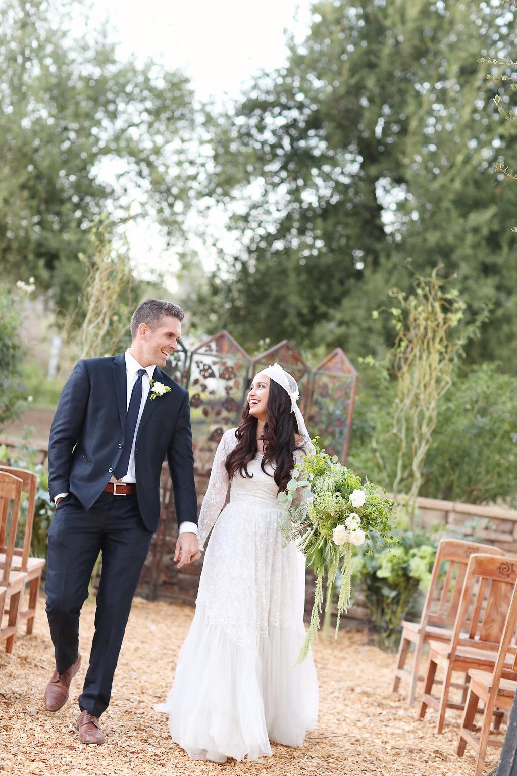 Bride in a vintage wedding dress with vintage veil and groom.