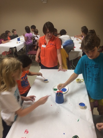 Campers mix colors to paint their pinch pots!