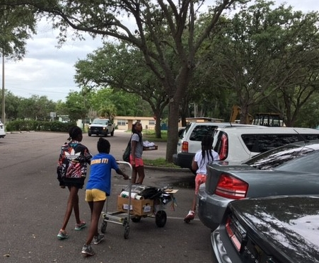 Students are always eager to help Instructors transport art supplies to their cars at end-of-day.