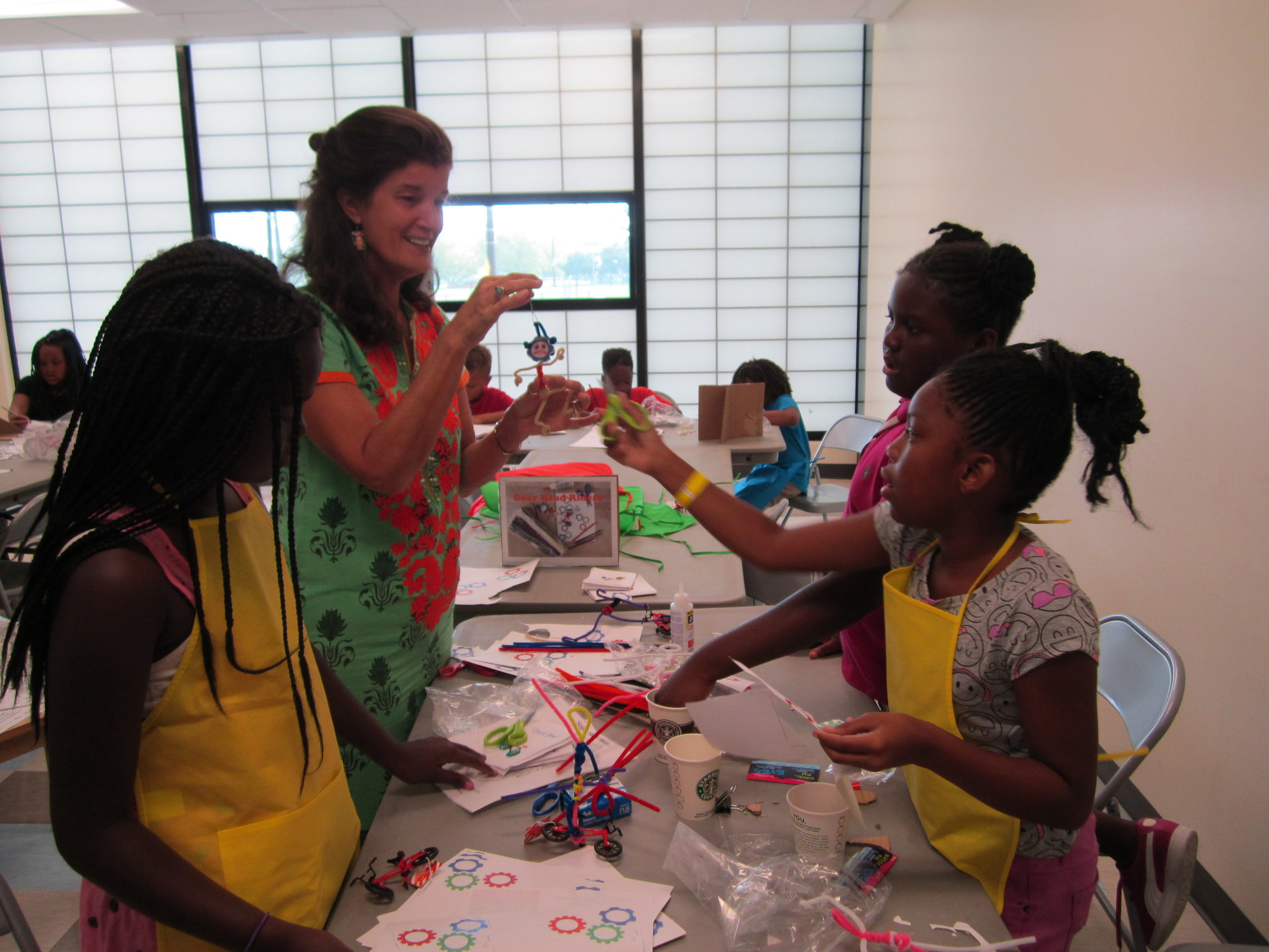 Ms. Cora works with the girls at Campbell Park Rec. Center on their sculptures.