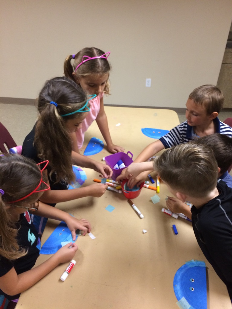Campers enthusiastically choose the colors for their pattern jellyfish!