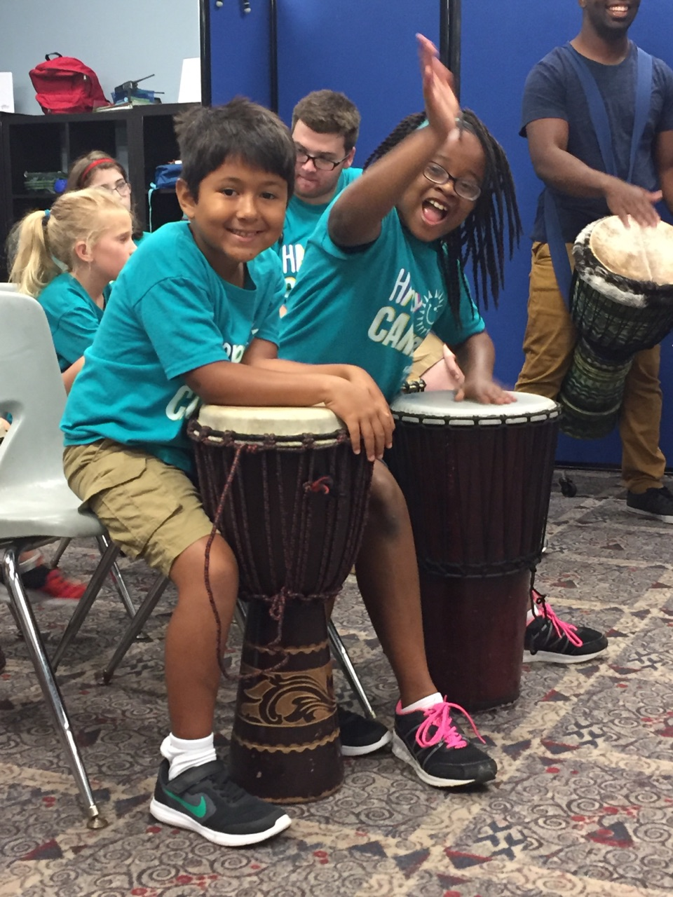 Campers were all smiles while participating in a drum circle with Giving Tree Music!