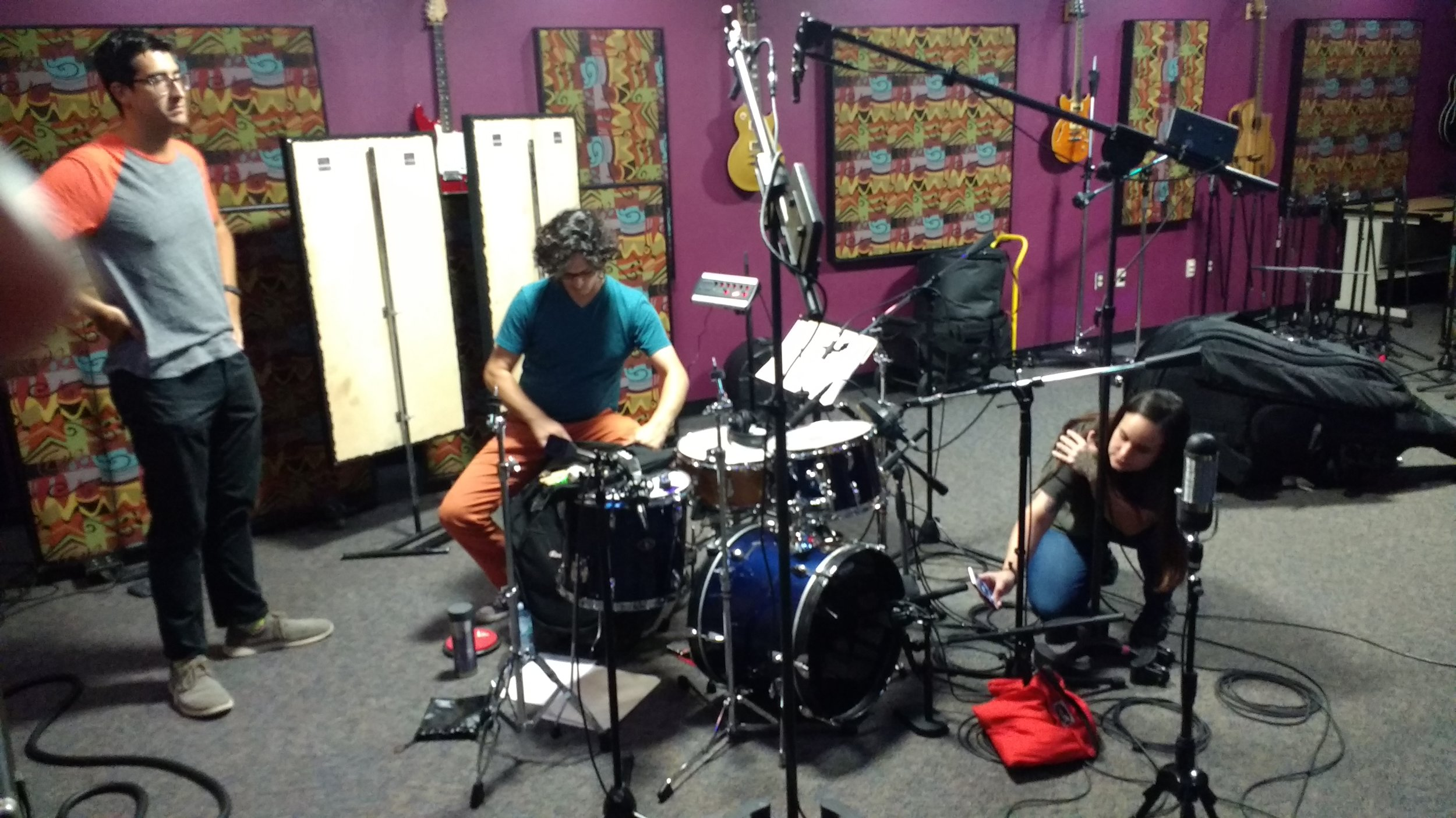 Alejandro, Mark and Melissa setting up for a session.