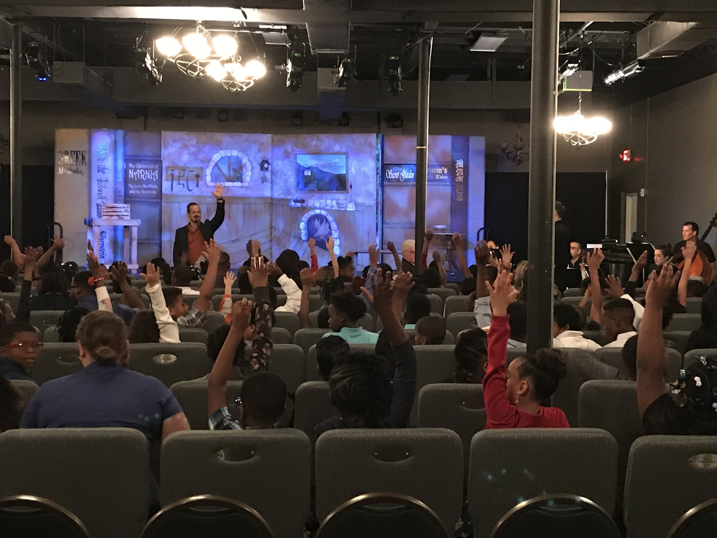 Maestro Sforzini asks kids to raise hands if this is their very first opera. 95% say yes!