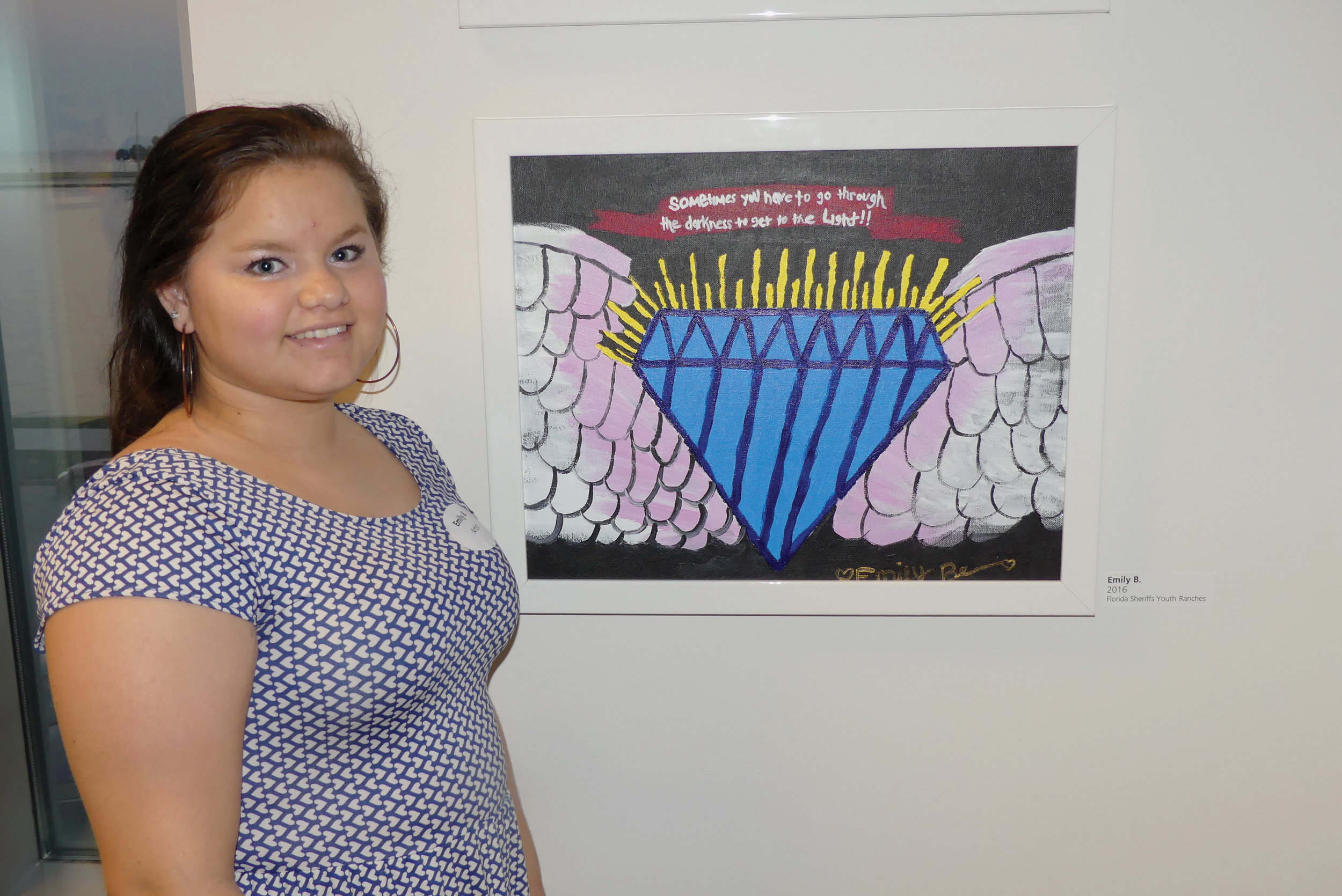 This is Emily with her work of art for the 2016 Young Artists of Florida Exhibition at the Museum of Fine Arts, St. Petersburg.