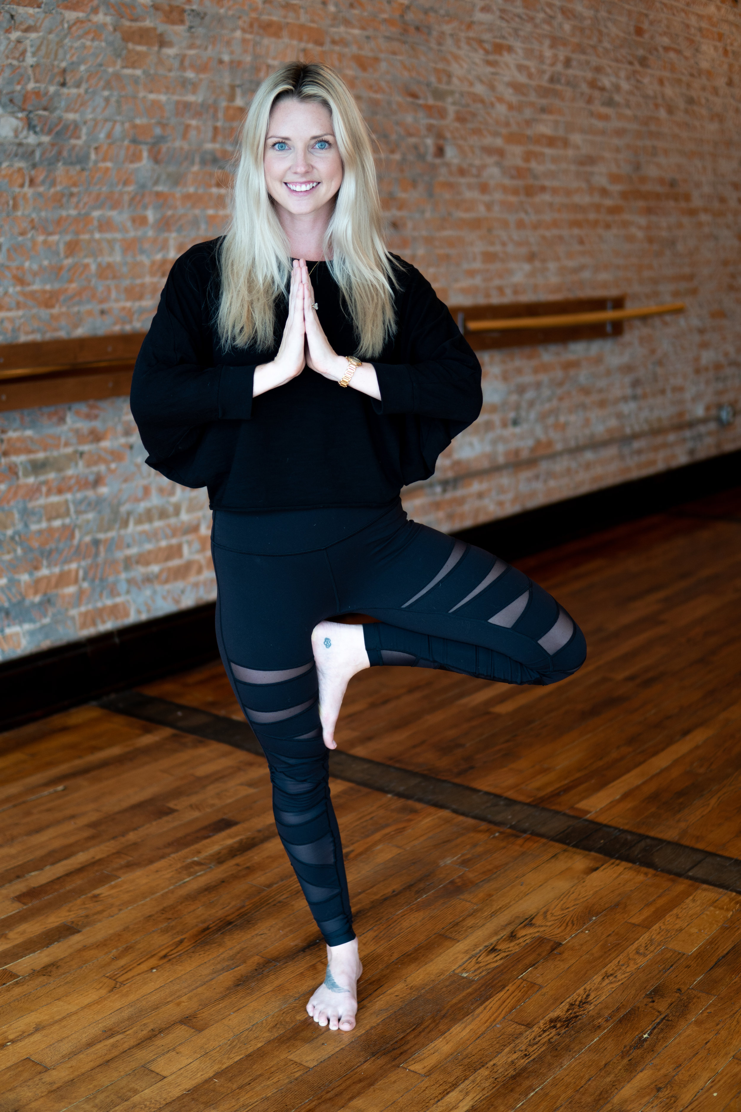 """CHELSEA YARBROUGH  DIRECTOR OF OPERATIONS  E-RYT 250  SHE/HER/HERS  Chelsea was drawn to yoga as a way to cultivate better mental health– a way to """"workout"""" her mind, and not just her body. Being on her mat grew into a way of life. A few years later she moved to Chicago and found the universe was giving her the chance to invest in herself and she completed her 250 hour Power Yoga Training with Corepower Yoga. Since then she has also completed training in Prenatal, and Kids Yoga. Chelsea loves to guide her class in a creative flow that celebrates what their bodies can do. Her music inspires you to quiet your mind and let your body take the lead. She encourages you to take what you need from your mat and leave behind what you don't. Moving forward Chelsea is partnering with Jessica to open up a sister studio, Sage Yoga Hot, in OTR."""