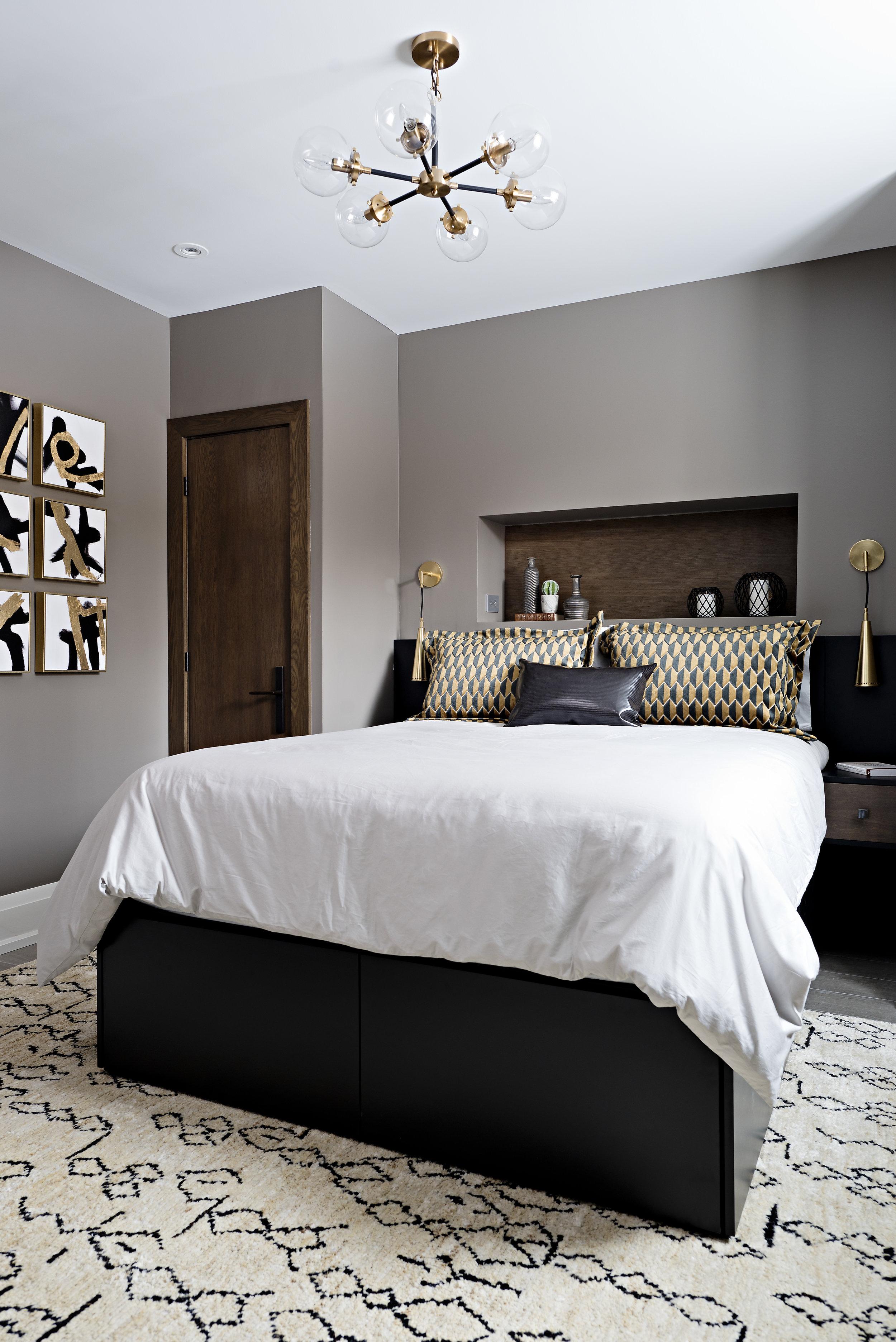 Interior Designer Pizzale Design Stylish Boys Bedroom Black and Gold Art and Pillows Custom Millwork.jpg
