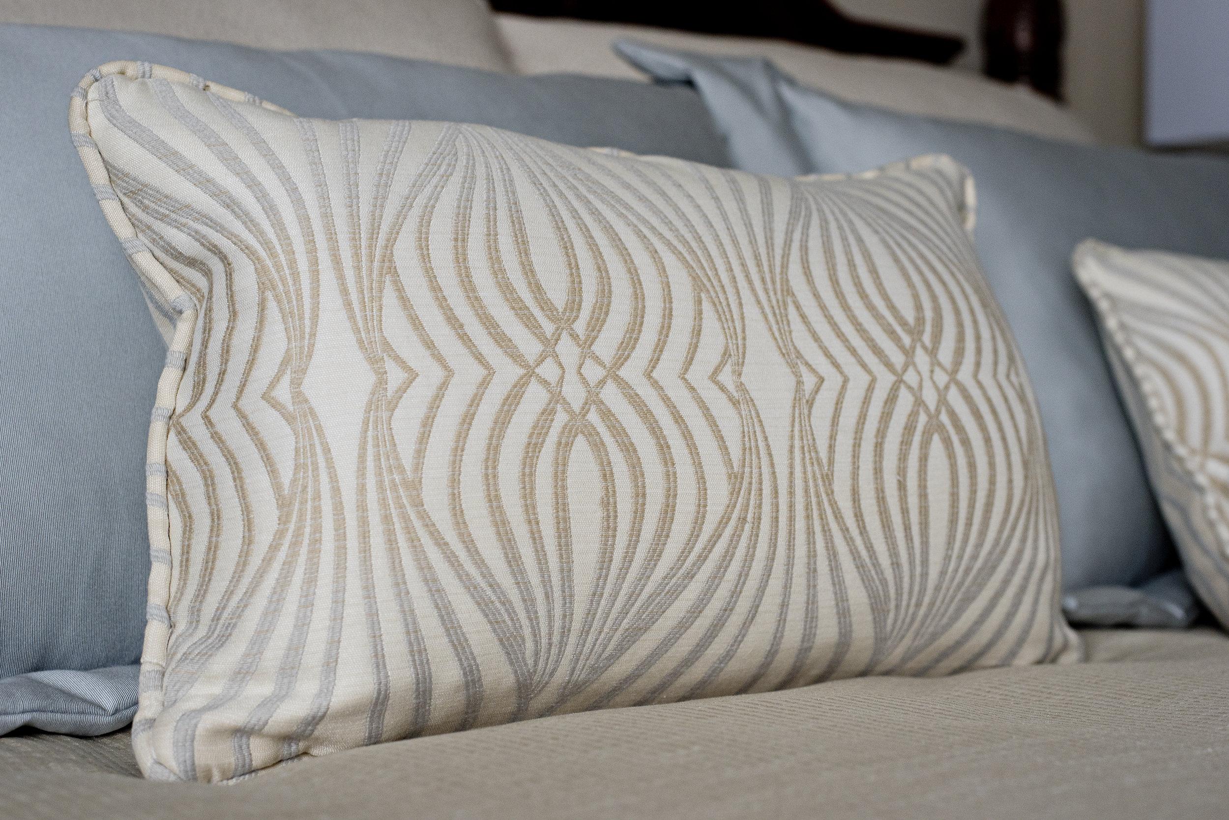 decorative simple wave pattern design beige and blue toss cushion bedding soft colour palette decor accessories.jpg