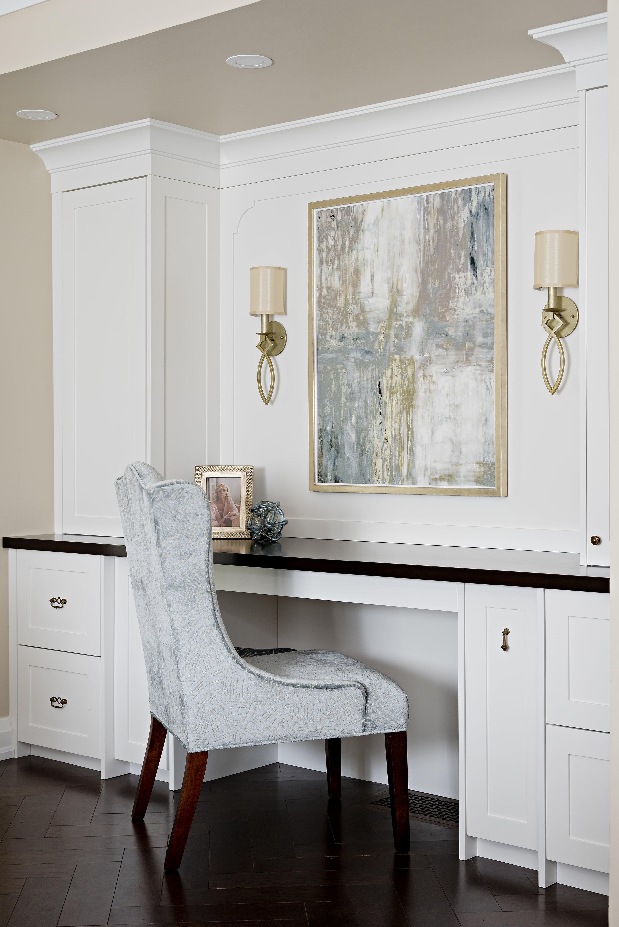 pizzale design interior design built in desk white shaker drawer cabinets brass sconce brass frame soft blue and beige colour palette light blue velvet dining chair.jpg