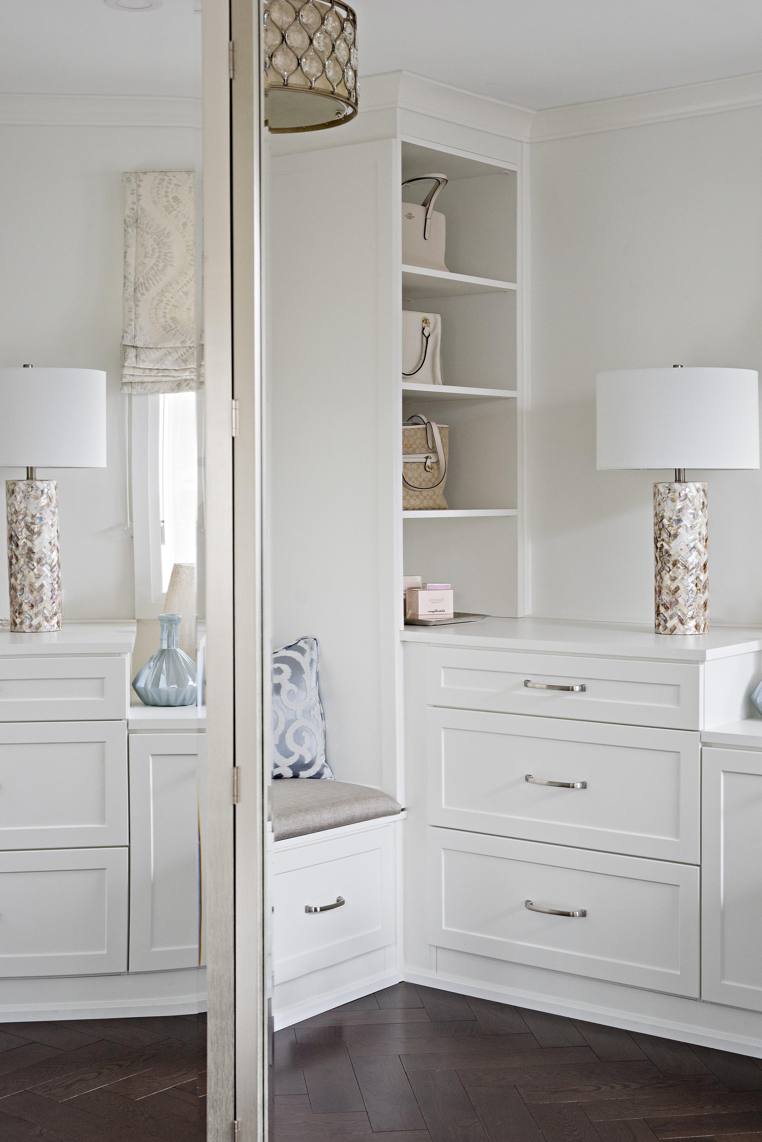 pizzale design interior design bedroom walk in closet white shaker cabinets open display storage dark hardwood herringbone flooring .jpg