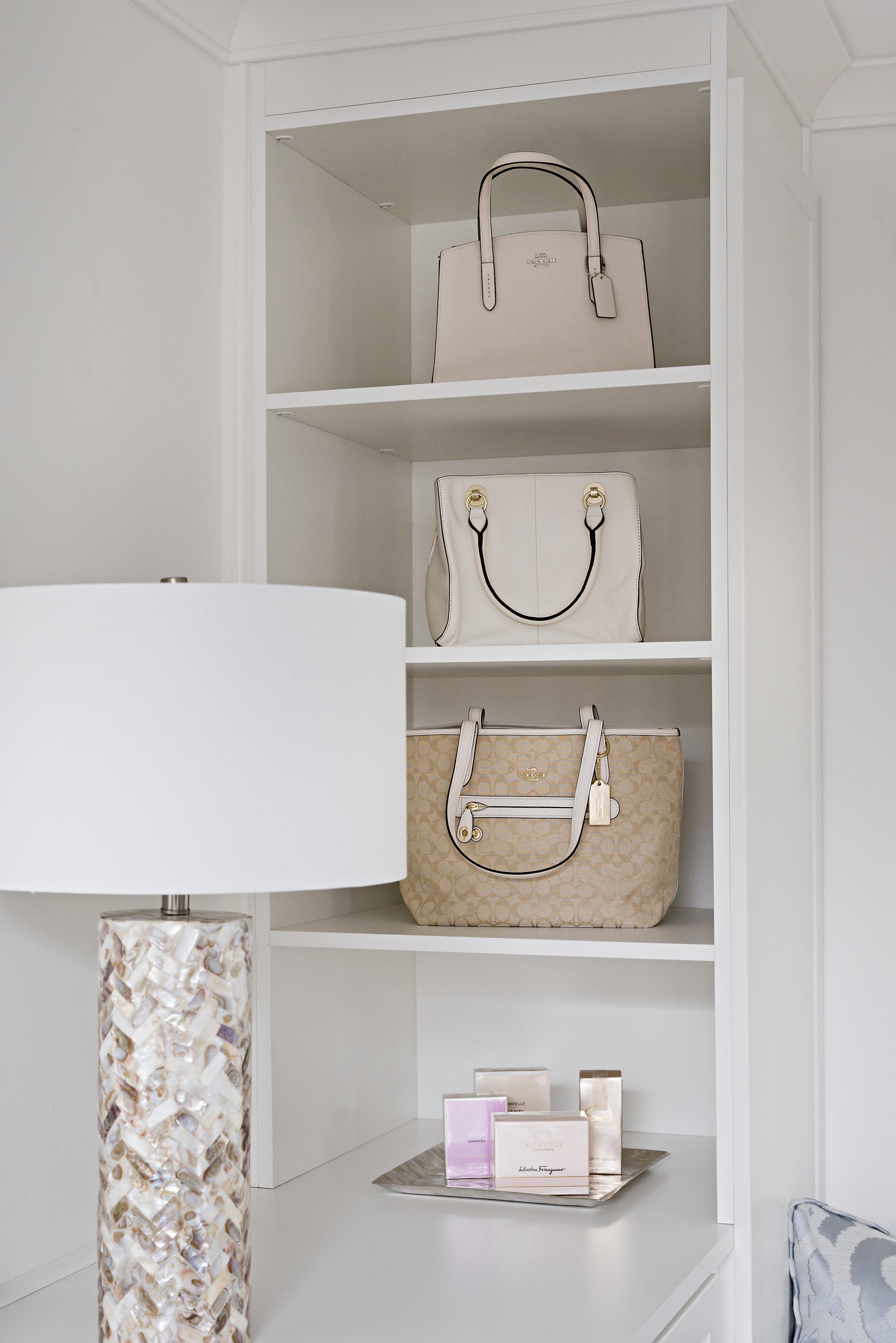 pizzale design interior design decorarion closet organization purse display storage open cabinet white clean crisp simple bright.jpg