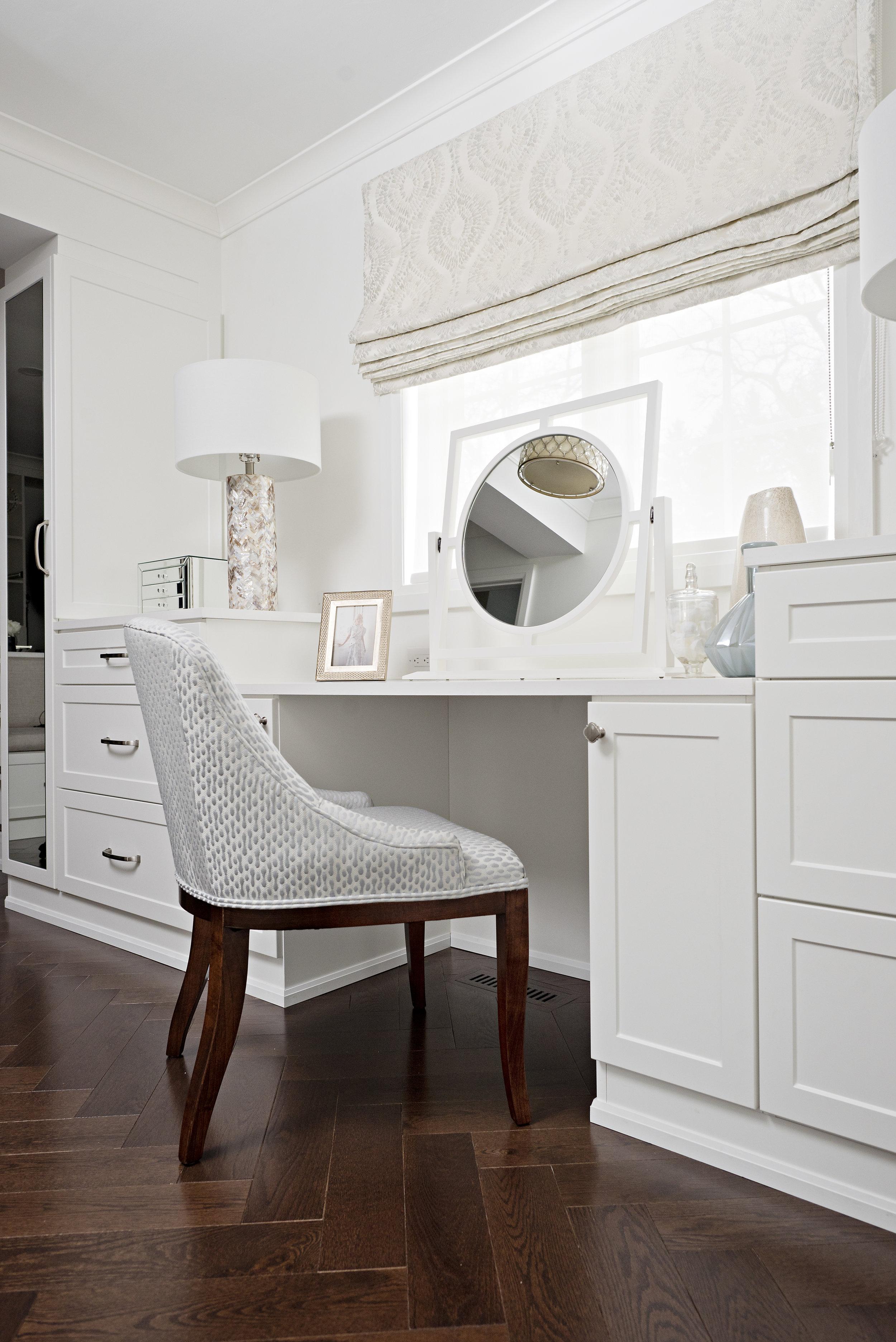 pizzale design interior design make up vanity reupholstery dark herringbone install flooring unique mirror tone on tone pattern roman fabric shade wall panelling white walk in closet.jpg