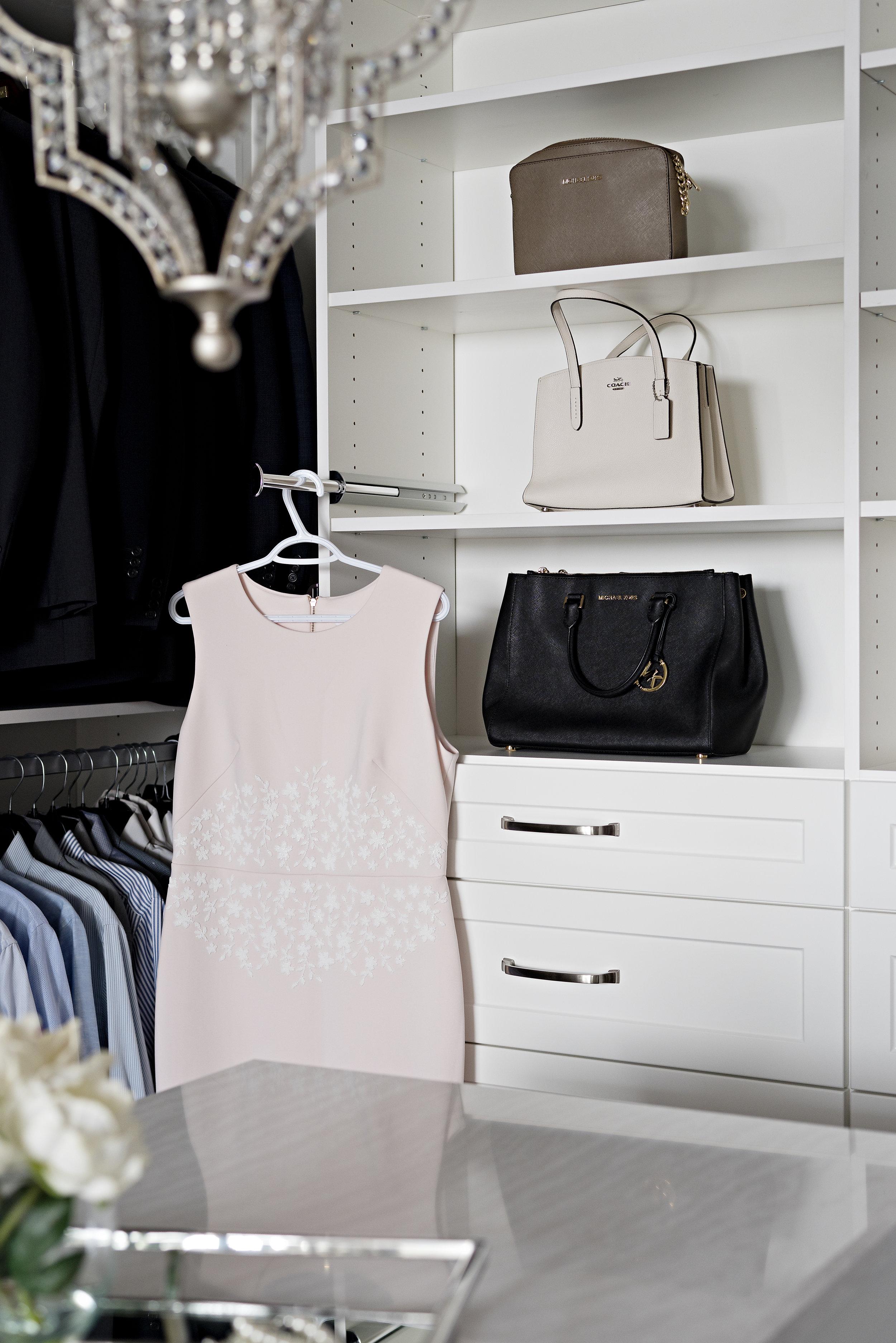 pizzale design interior design walk in closet organization hanging clothes polished chrome finish purse open storage white shaker cabinet drawer .jpg