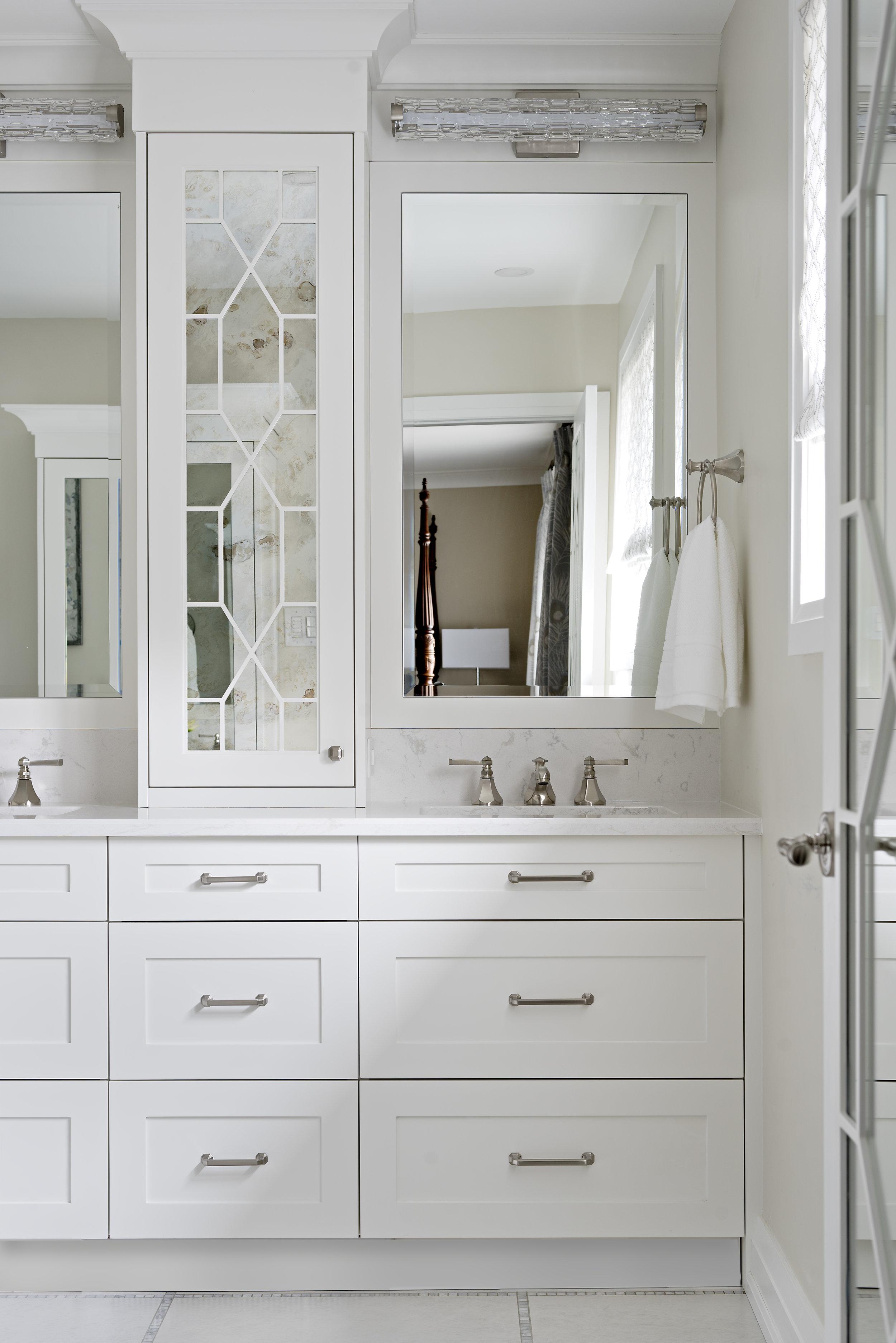 pizzale design interior design white bathroom shaker vanity white quartz countertop antique mirror cabinet door accent moulding satin nickel widespread faucet marble inlay floor tile.jpg