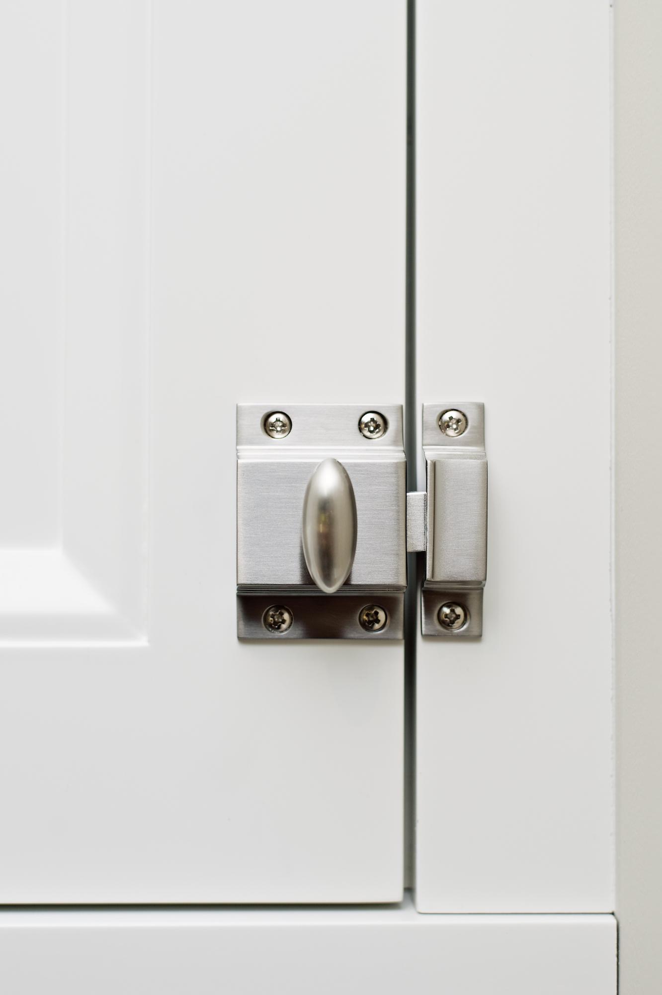 11 Pizzale Design Interior Decorating white millwork lock door .jpg