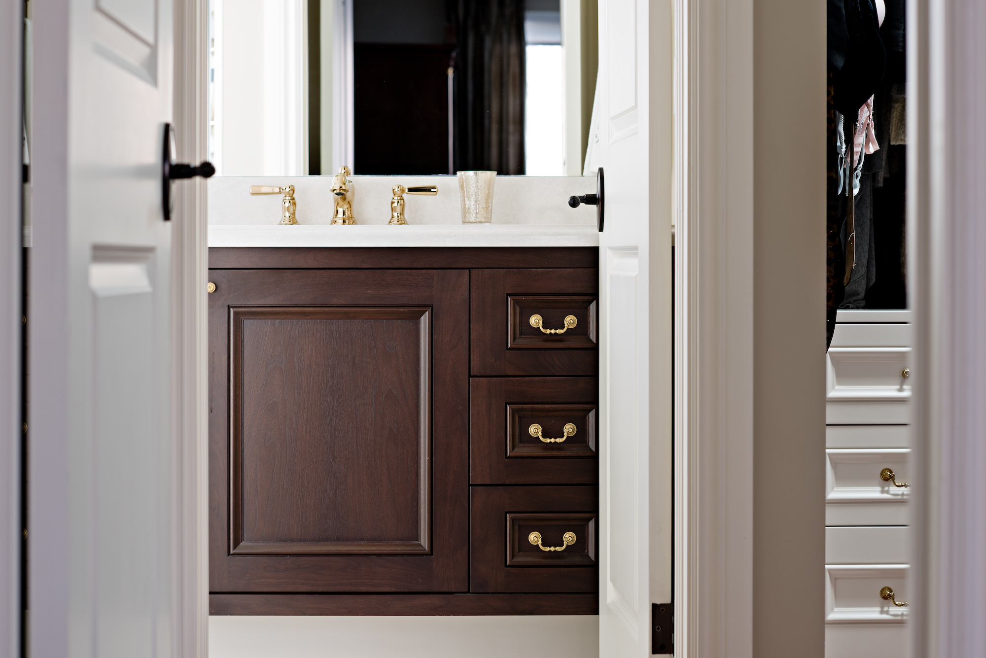 11 Pizzale Design Interior Decorating  bathroom elegant clean simple dark wood custom millwork gold hardware.jpg