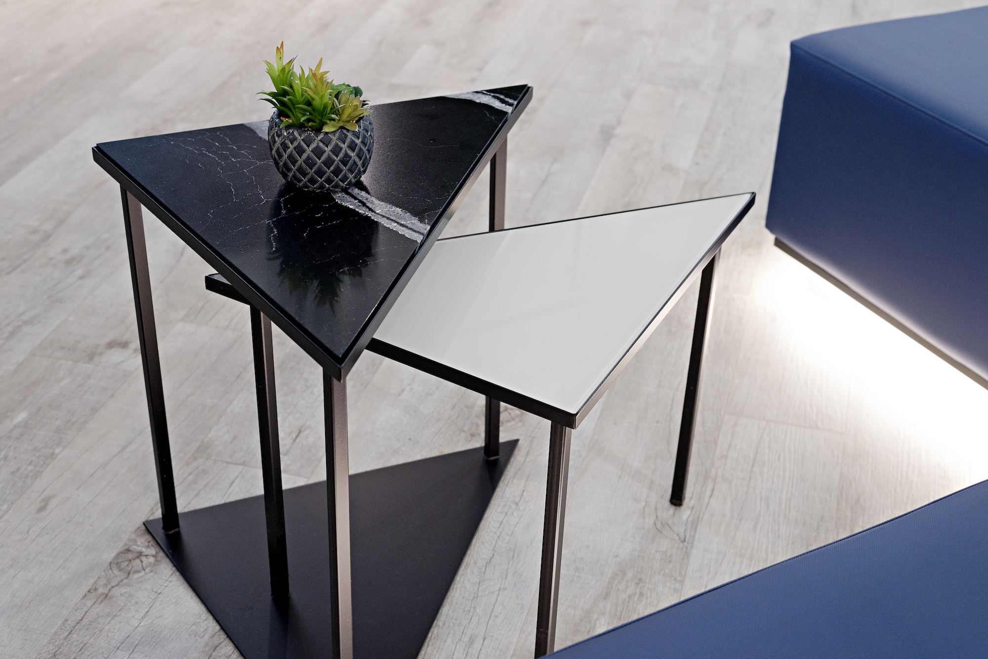 3 pizzale design interior design commercial triangle table quartz metal nesting tables succulent blue bench led lighting black accent custom grey laminate flooring.jpg