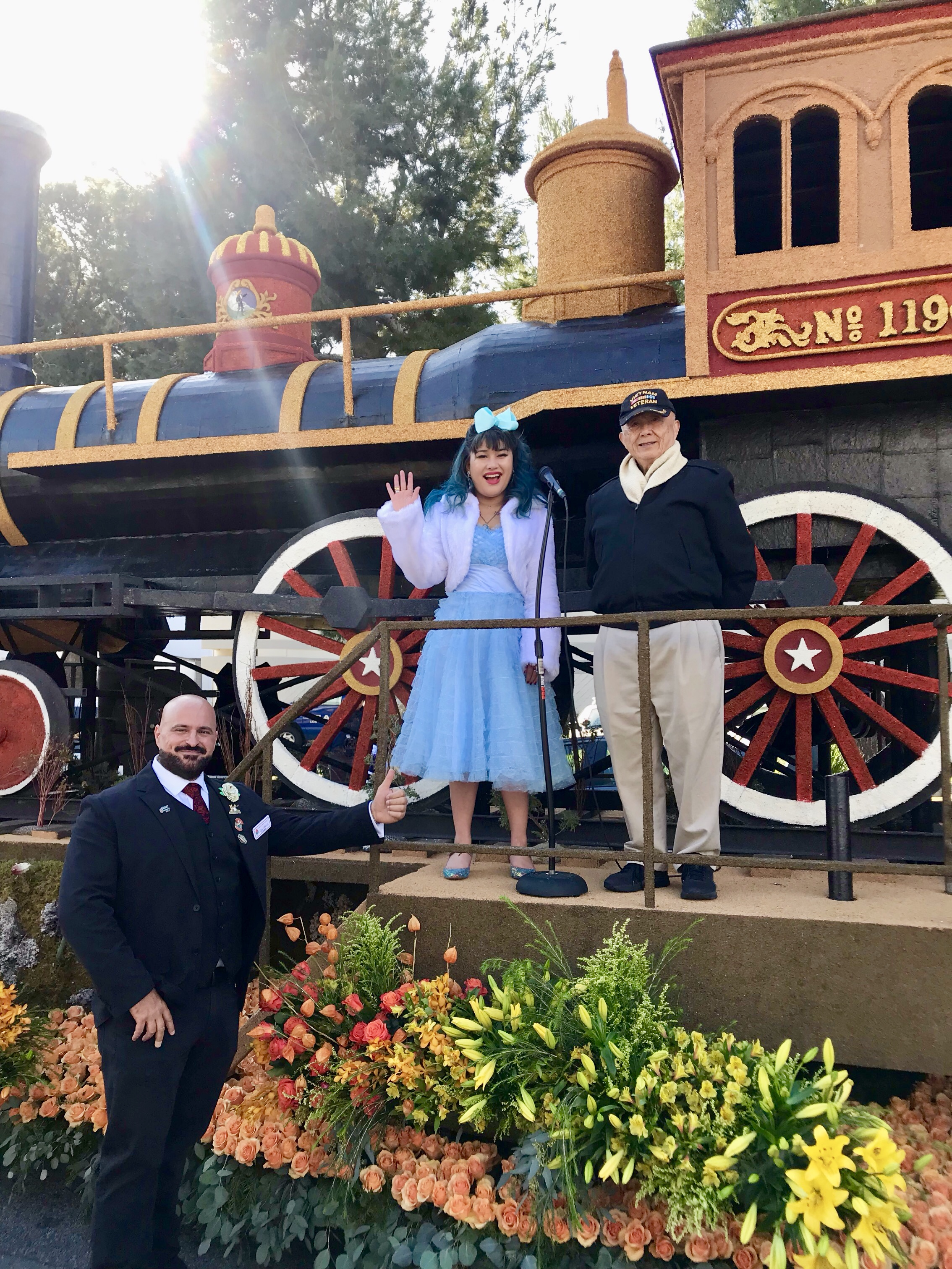 Blythe and Major General Chen pose with the Harmony Through Union float designer, Mike Abboud, during Judging Day, December 31st, 2018.