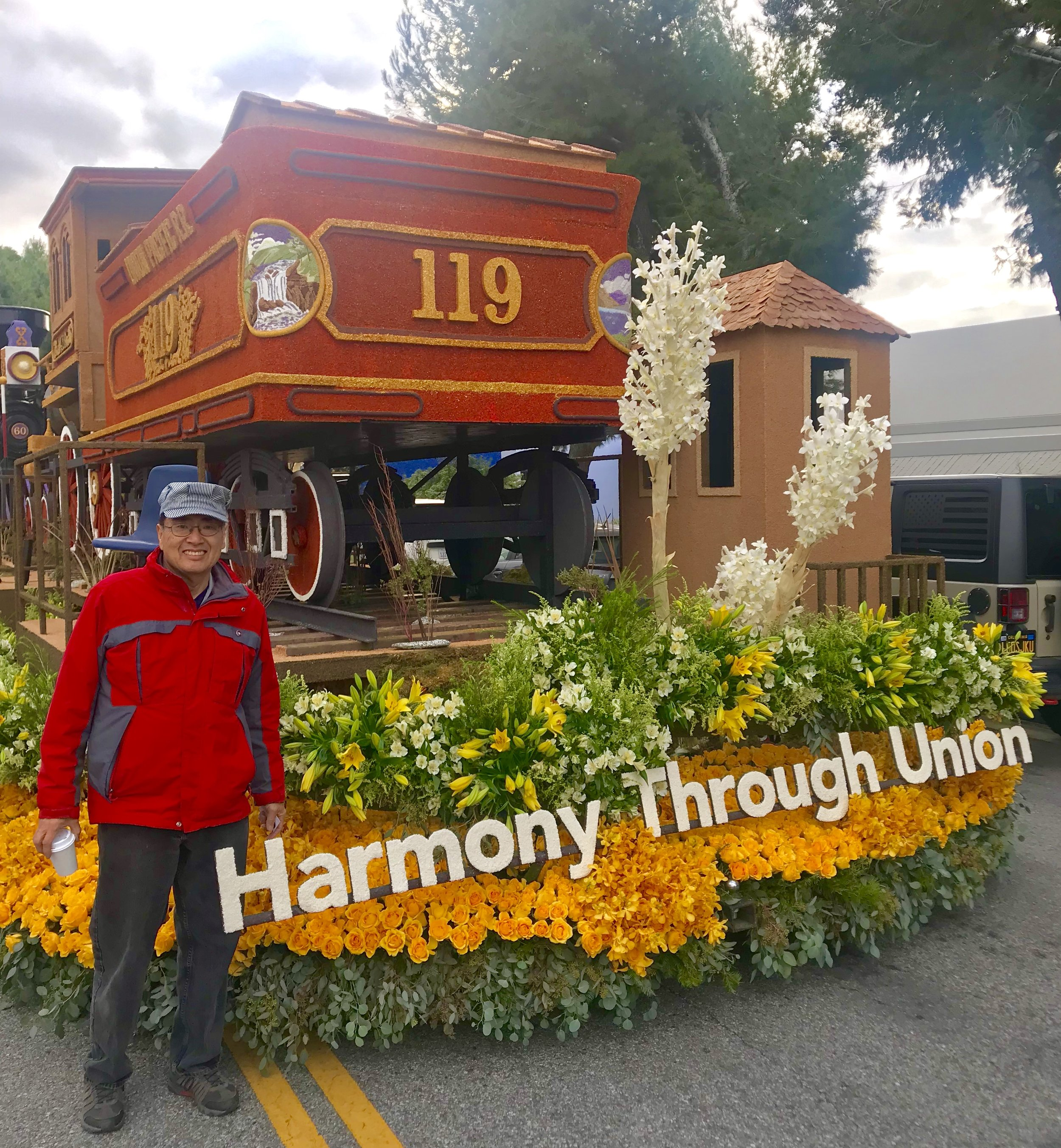 Calvin Fujiwara, the float's animator and observer, poses on Judging Day at the front of the Harmony Through Union float.