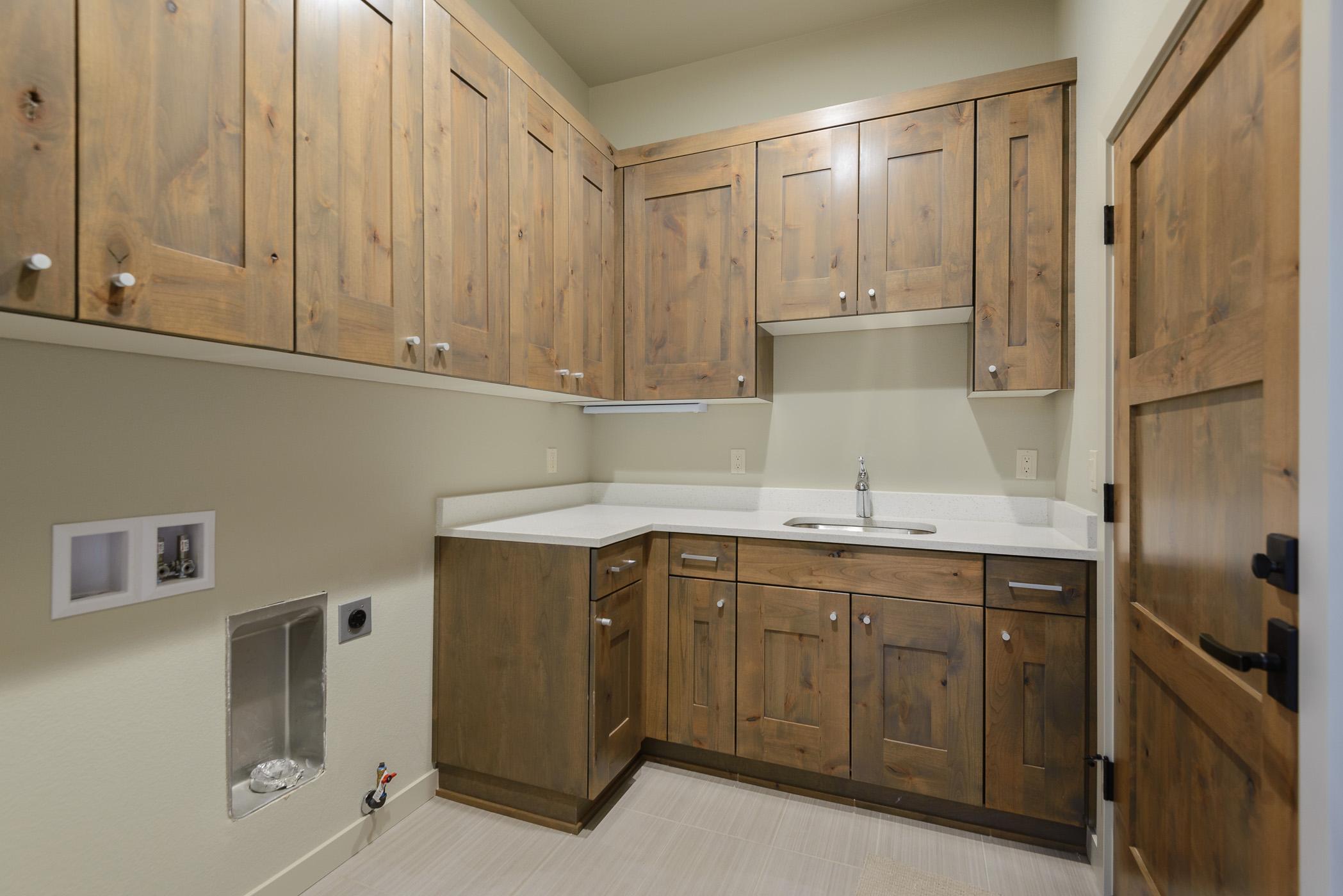 Milepost 1 Model Home laundry room