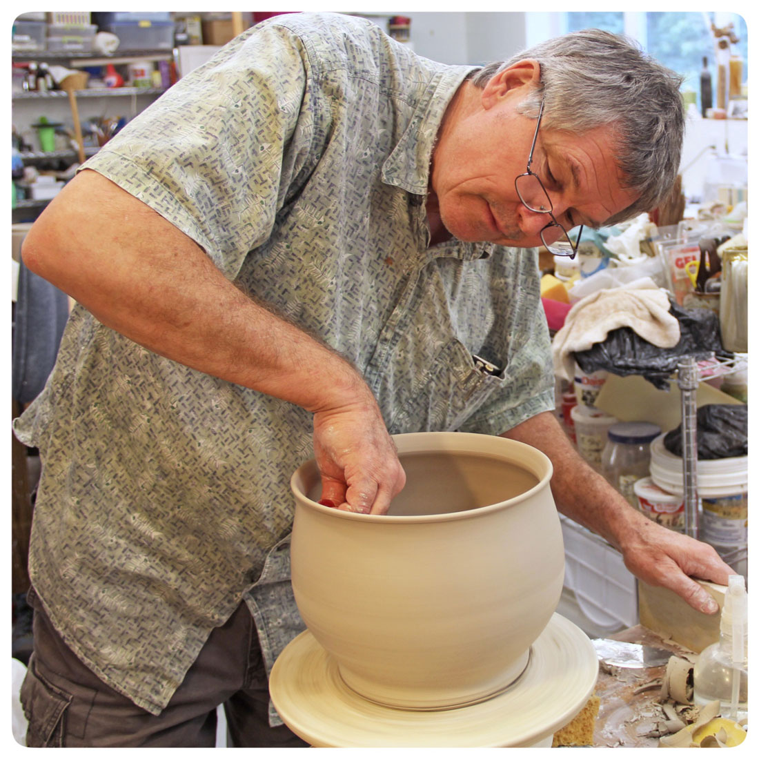Bruce Gholson throwing a deep serving bowl at Bulldog Pottery, Seagrove, North Carolina